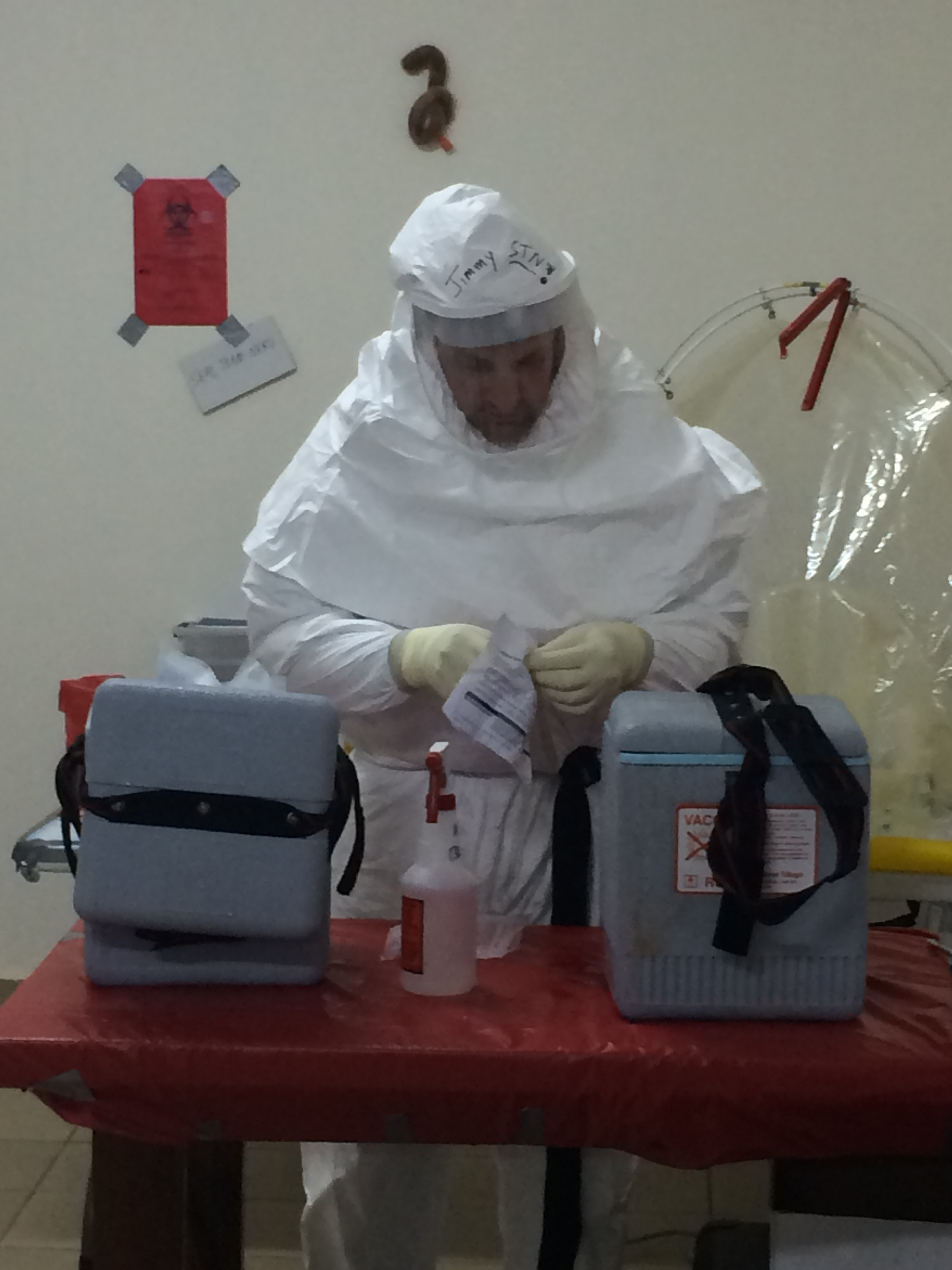 Lt. James Regeimbal decontaminates and inspects sample documentation received at a Naval Medical Research Center mobile laboratory in Liberia on Oct. 3, 2014. US Navy Photo