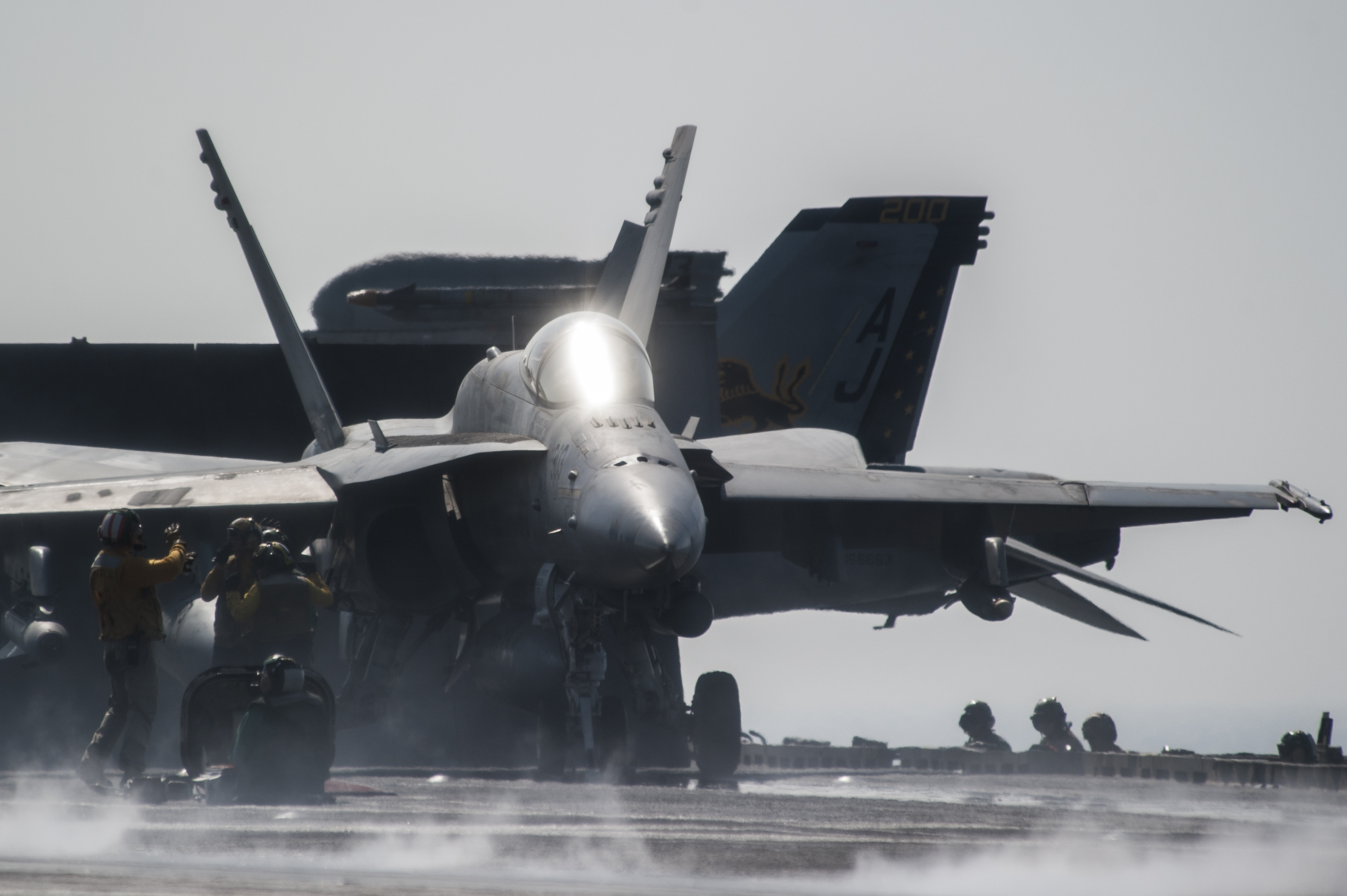 An F/A-18C Hornet assigned to the Valions of Strike Fighter Squadron (VFA) 15 takes off from the flight deck of the aircraft carrier USS George H.W. Bush (CVN-77). US Navy Photo