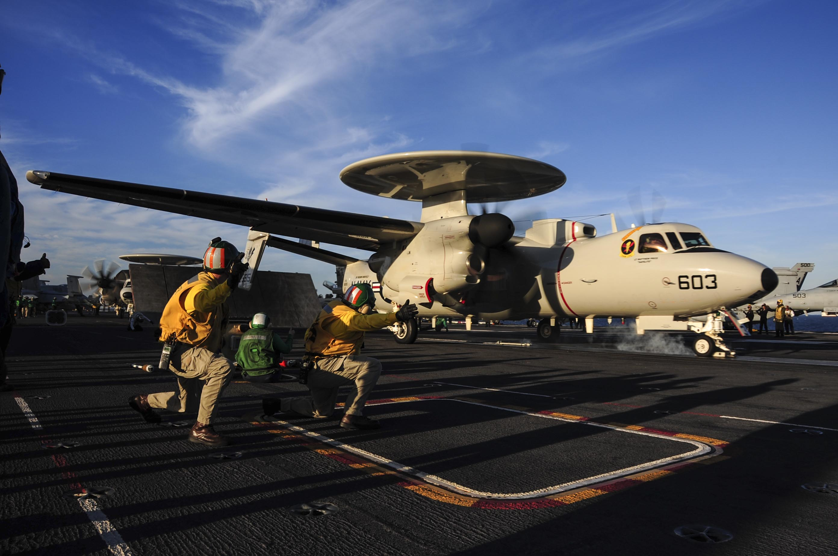 An E-2D Hawkeye assigned to the Tiger Tails of Carrier Airborne Early Warning Squadron (VAW) 125 launches off the flight deck of the aircraft carrier USS Theodore Roosevelt (CVN-71). US Navy Photo