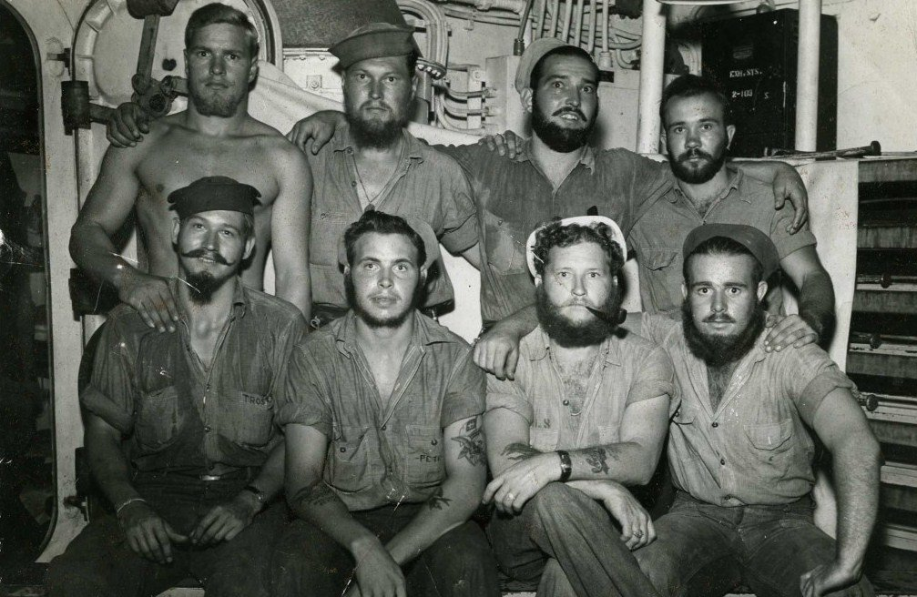 USS Pensacola proudly display their facial hair circa 1944