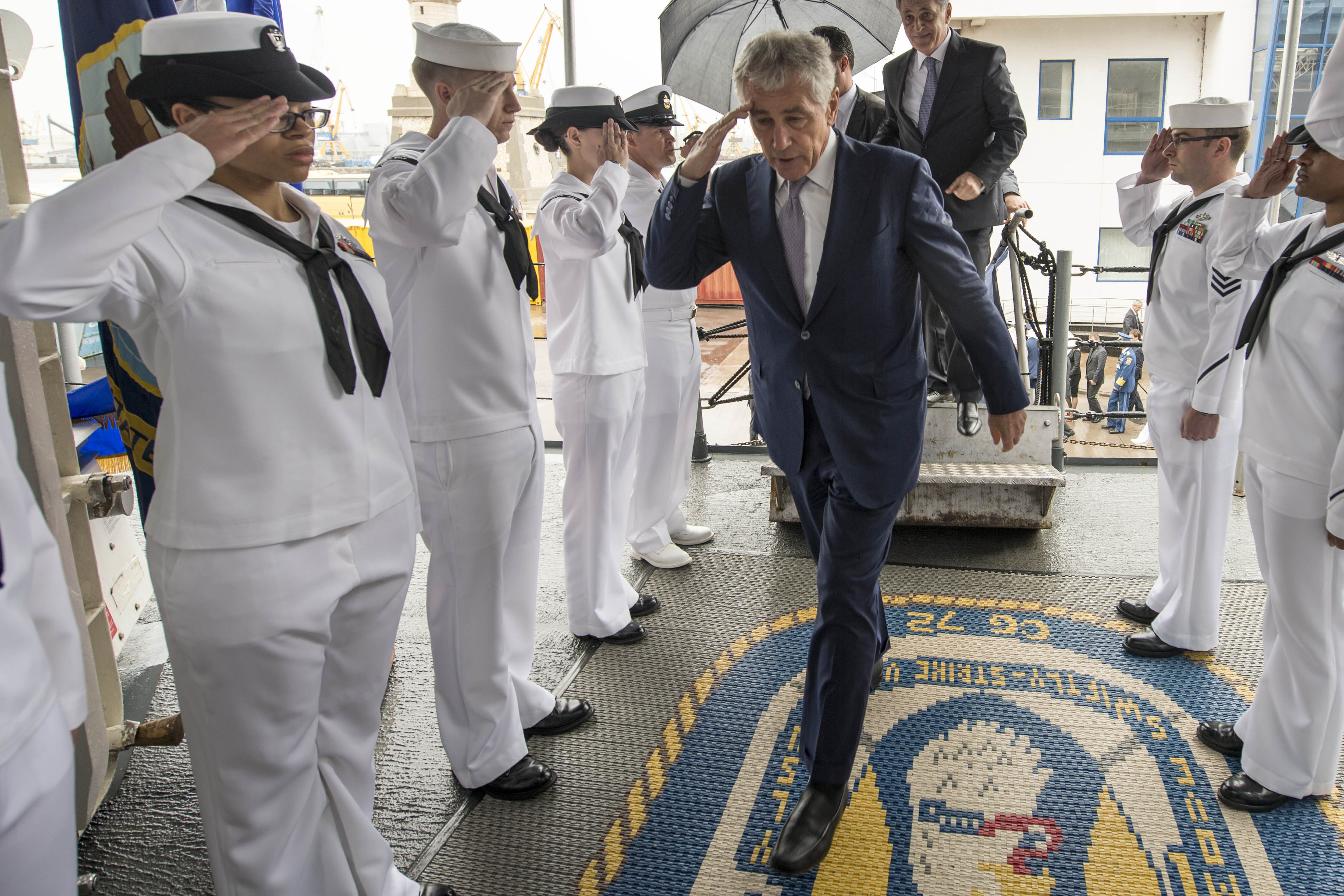 Secretary of Defense (SECDEF) Chuck Hagel is saluted by side boys as he visits the Ticonderoga-class guided-missile cruiser USS Vella Gulf (CG-72) on June 5, 2014. US Navy Photo