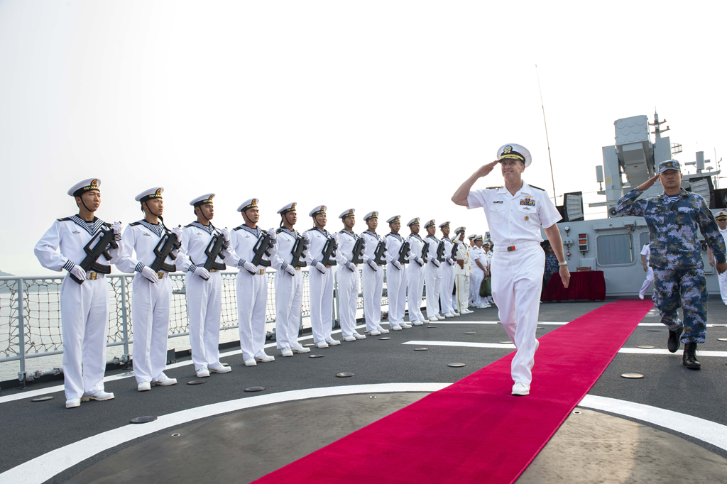 Chief of Naval Operations (CNO) Adm. Jonathan Greenert departs the People's Liberation Army Navy (PLAN) ship Datong FFG 580 on July 17, 2014. US Navy Photo