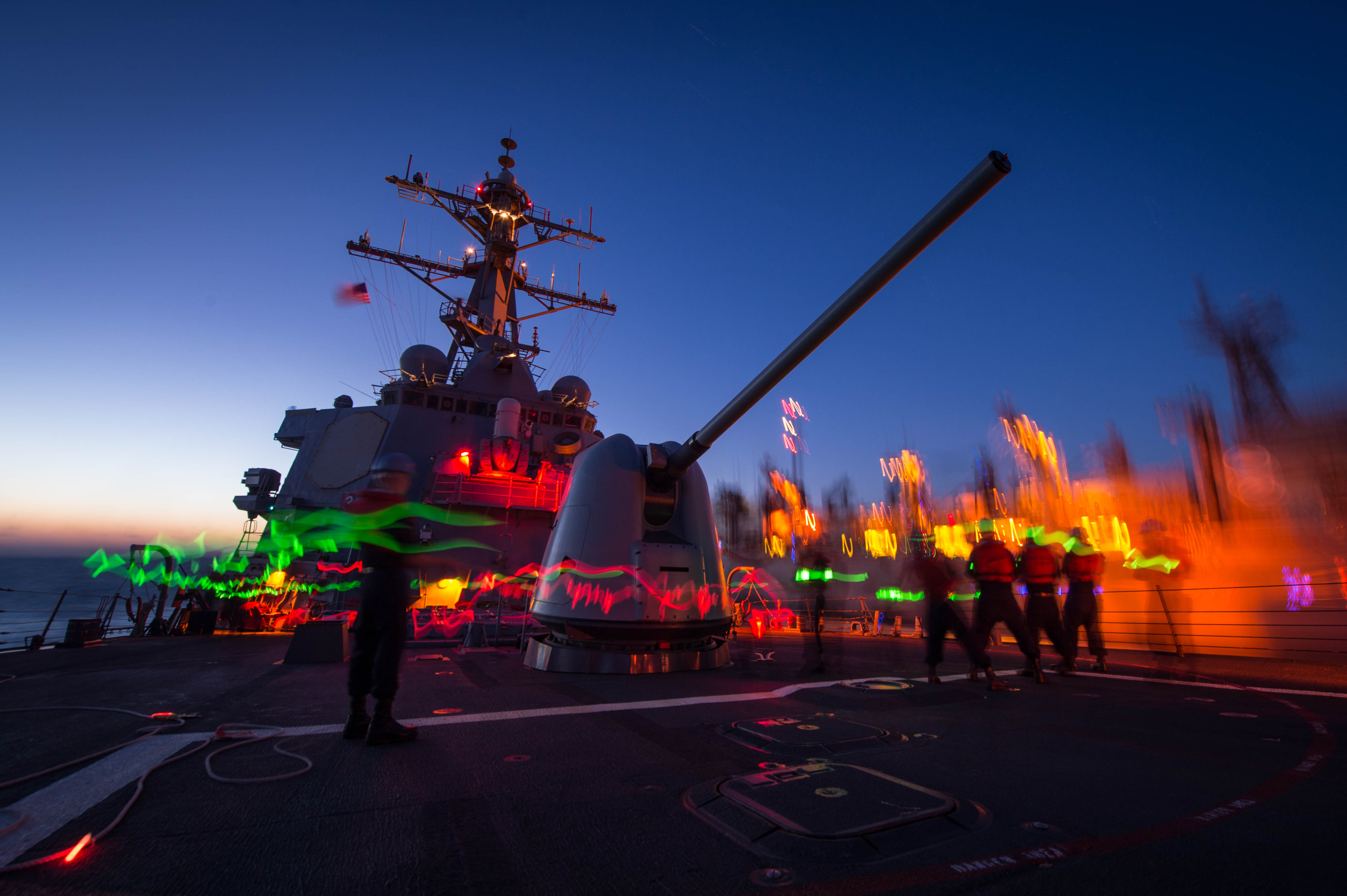 Sailors man the phone and distance line aboard the Arleigh Burke-Class guided-missile destroyer USS Mitscher (DDG-57) on Nov. 7, 2014. US Navy Photo