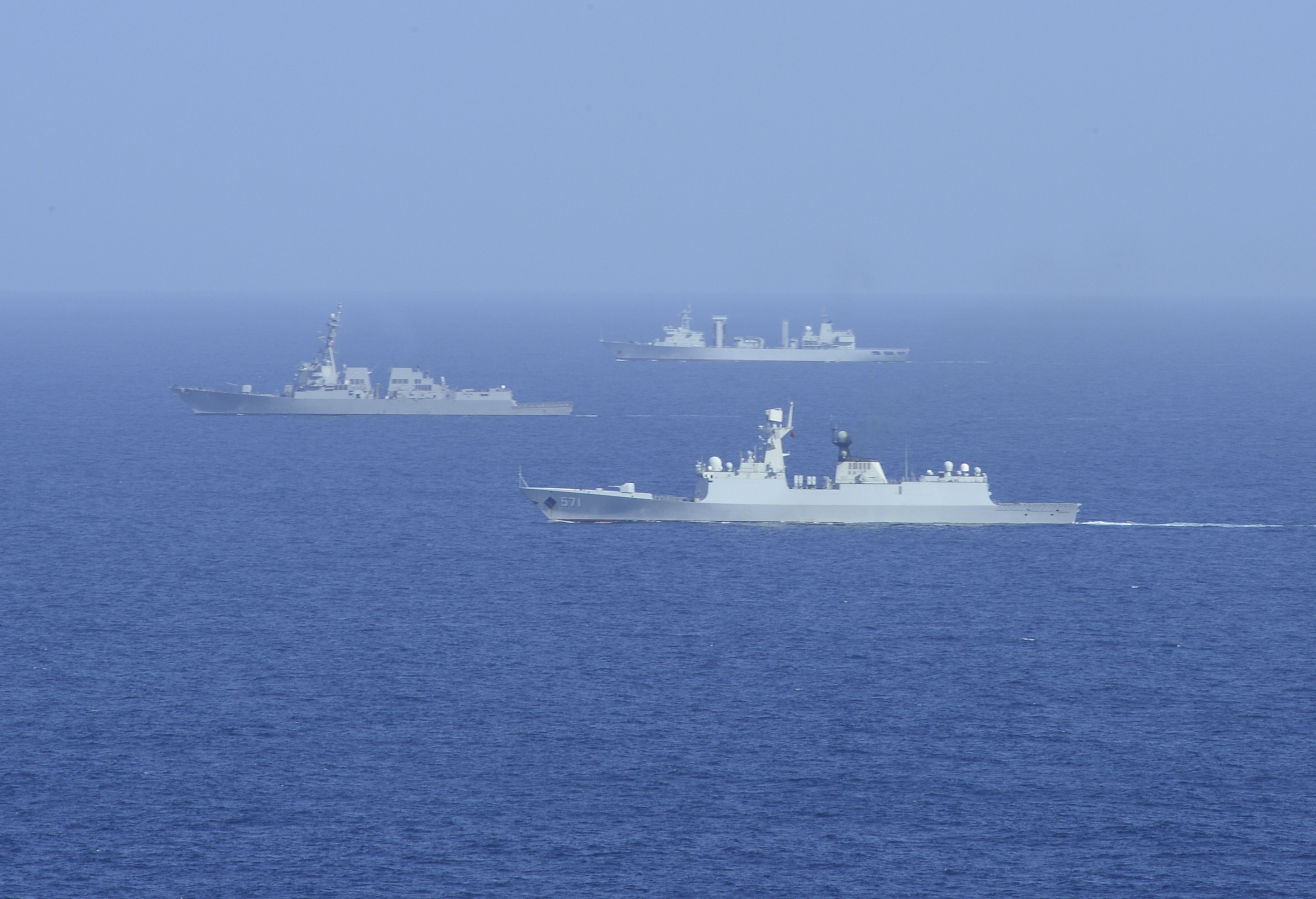 USS Sterett (DDG-104), left, transits alongside the Jiangkai II CNS Yun Chang (FFG571), right, and the Fuchi-class replenishment ship CNS Chao Hu (AOR 890) during U.S. - China Counter-Piracy Exercise 15 on Dec. 11, 2014. US Navy Photo