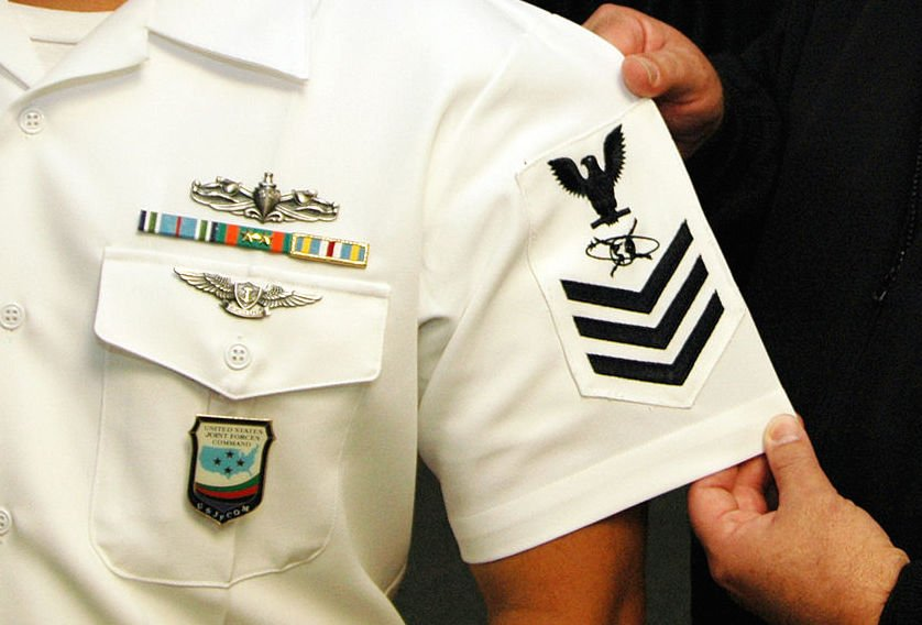 rating badge, worn by a newly minted Mass Communication Specialist 1st Class in 2006. Enlisted sailors are classified by their unique rates with their jobs worn on their sleeves. US Navy photo