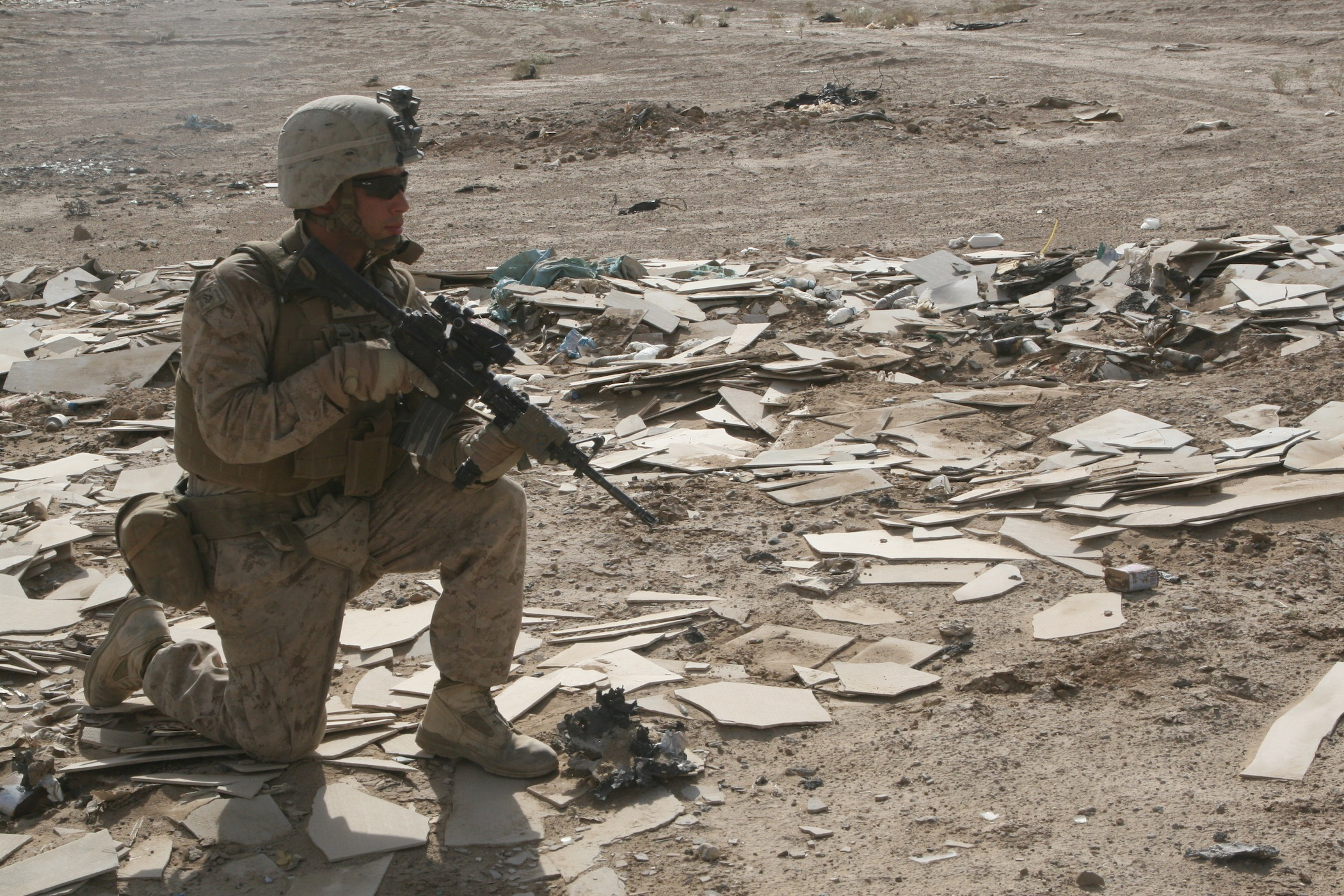 A Marine with Weapons Company, 1st Battalion, 2nd Marine Regiment, provides security during an operation in Helmand province, Afghanistan, Aug. 15, 2014. US Marine Corps Photo