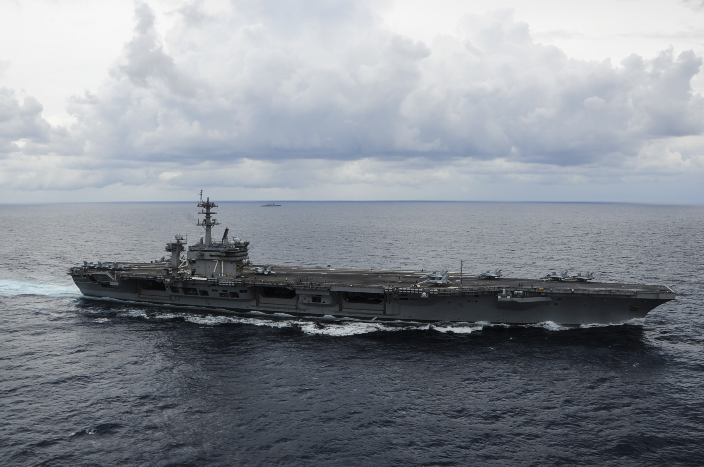 USS Theodore Roosevelt (CVN 71) transits in a strait transit formation with ships from Carrier Strike Group 12 on Sept. 20, 2014.