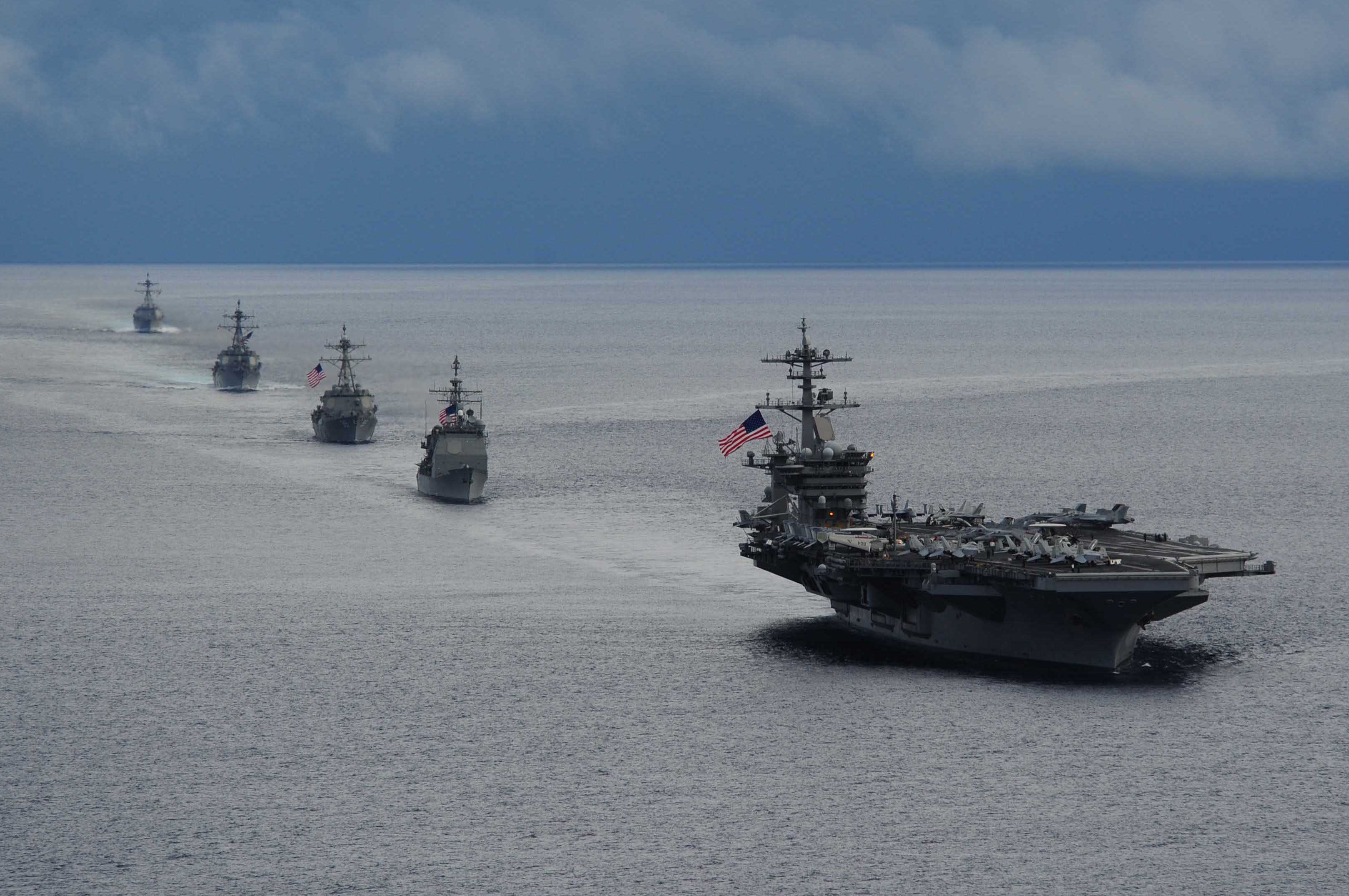 USS Theodore Roosevelt (CVN 71) leads a formation of ships from Carrier Strike Group (CSG) 12 during a maneuvering exercise on Sept. 23, 2014. US Navy Photo