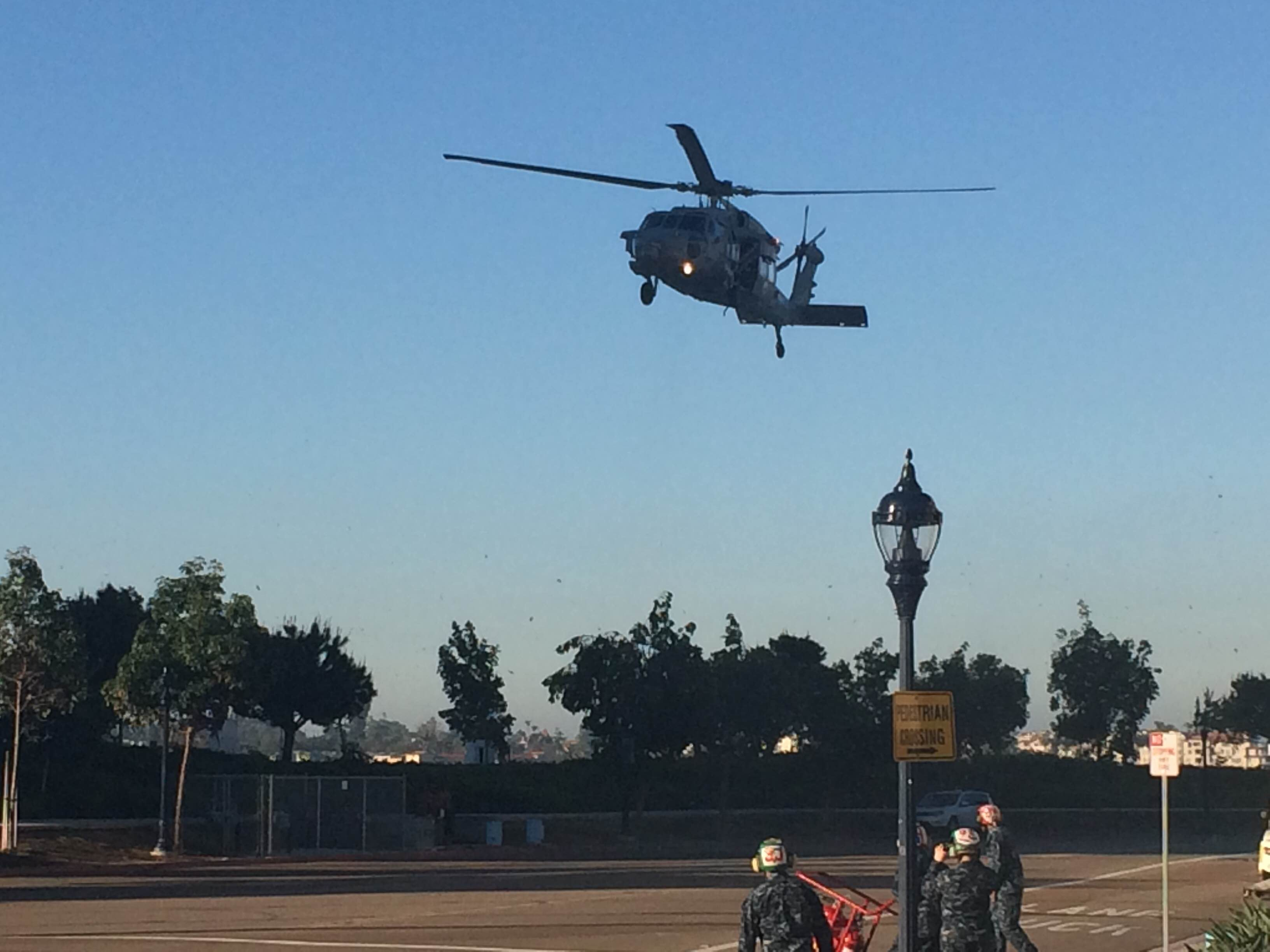 """A MH-60S Knighthawk from Helicopter Sea Combat Squadron Eight""""Eightballers"""" (HSC-8) lands on Feb. 7, 2015 outside the San Diego Convention Center. Photo Courtesy Jennifer Miller"""