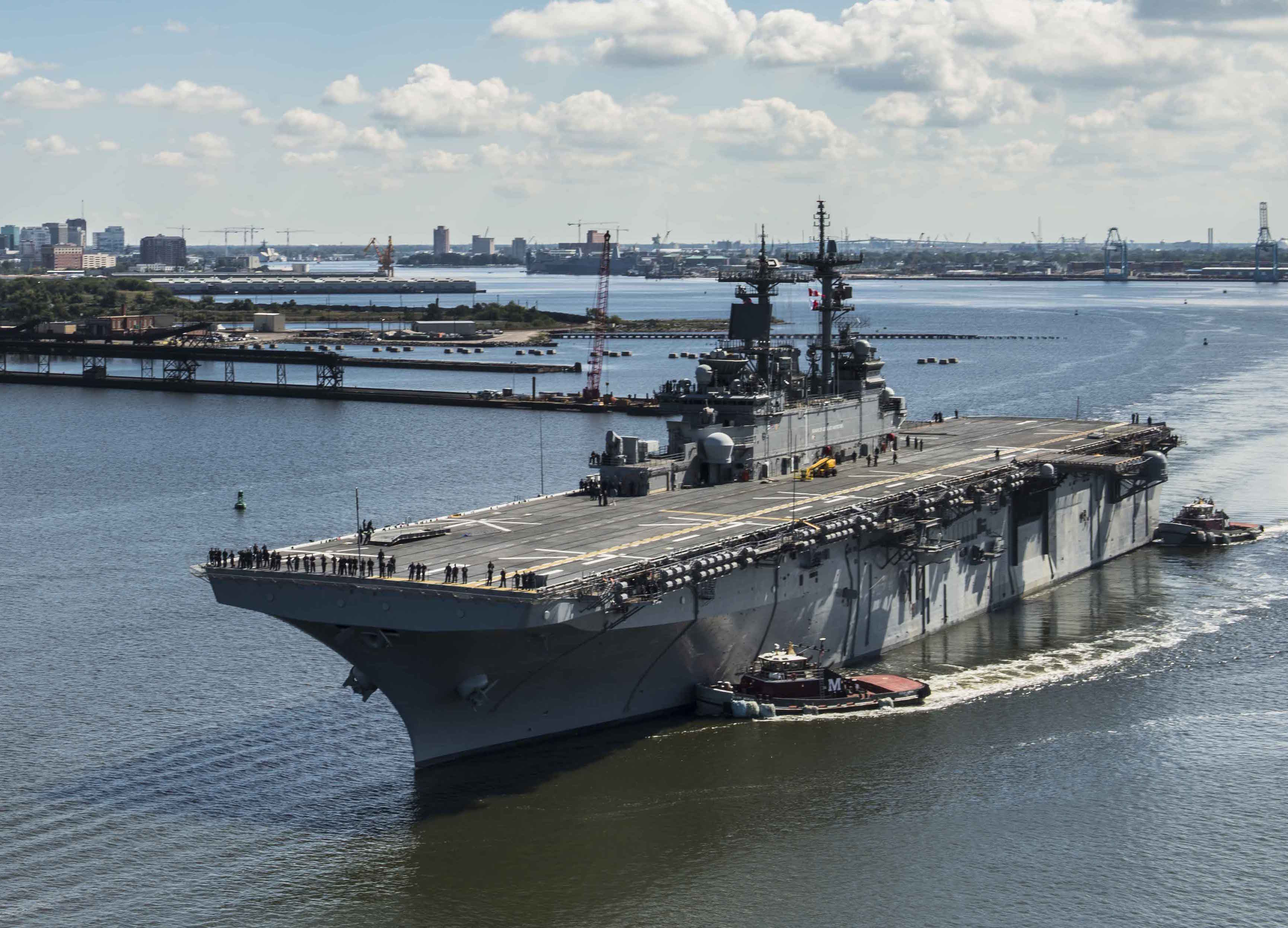 USS Wasp (LHD 1) transits the Elizabeth River from BAE Systems Norfolk to Naval Station Norfolk. Wasp completed a year-long dry dock phased maintenance availability period which included upgrades to her combat systems, engineering spaces and flight deck on Sept. 30, 2014. US Navy Photo