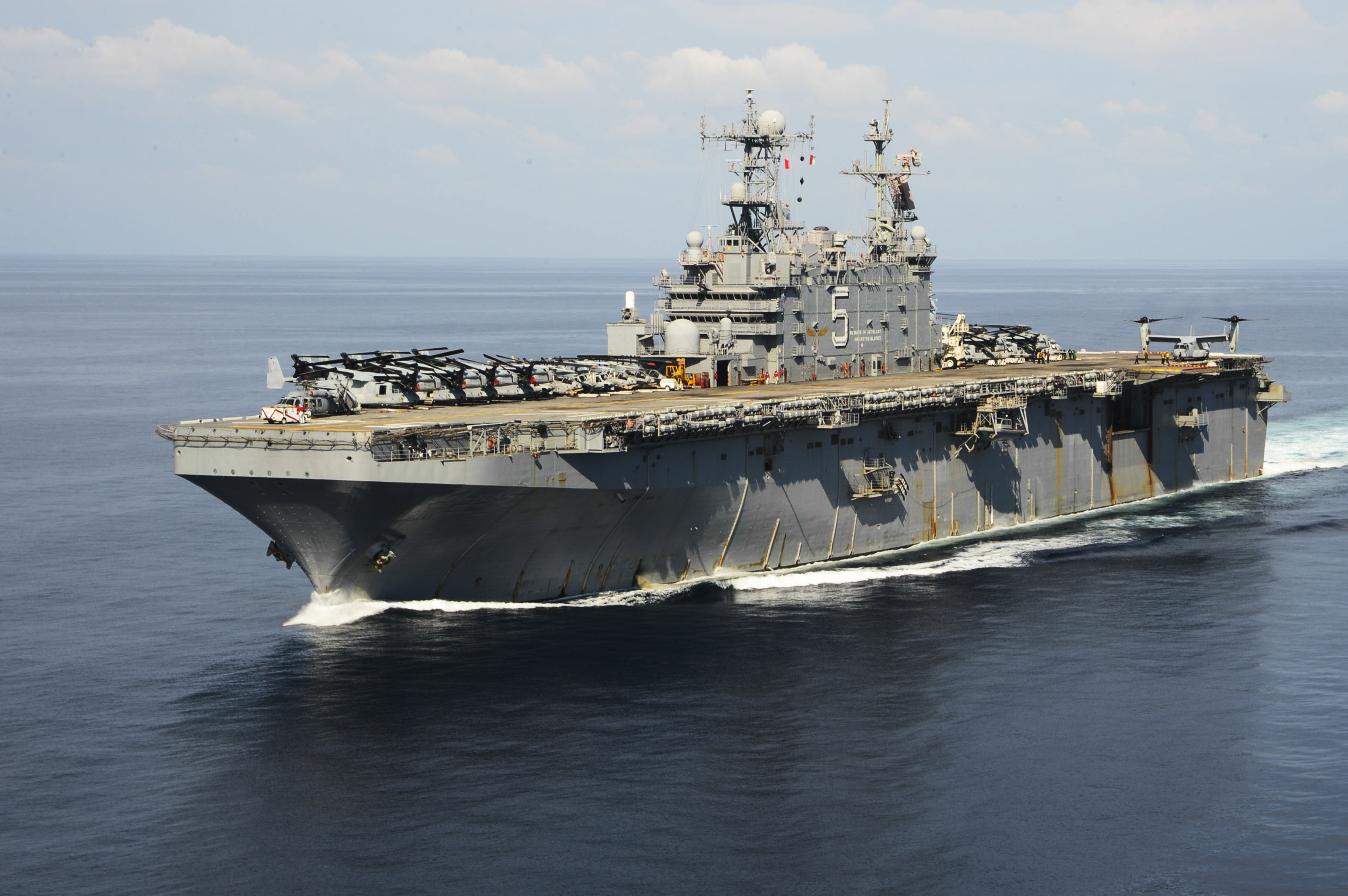 USS Peleliu (LHA 5) is underway in the Philippine Sea in its last 2014 deployment. US Navy Photo