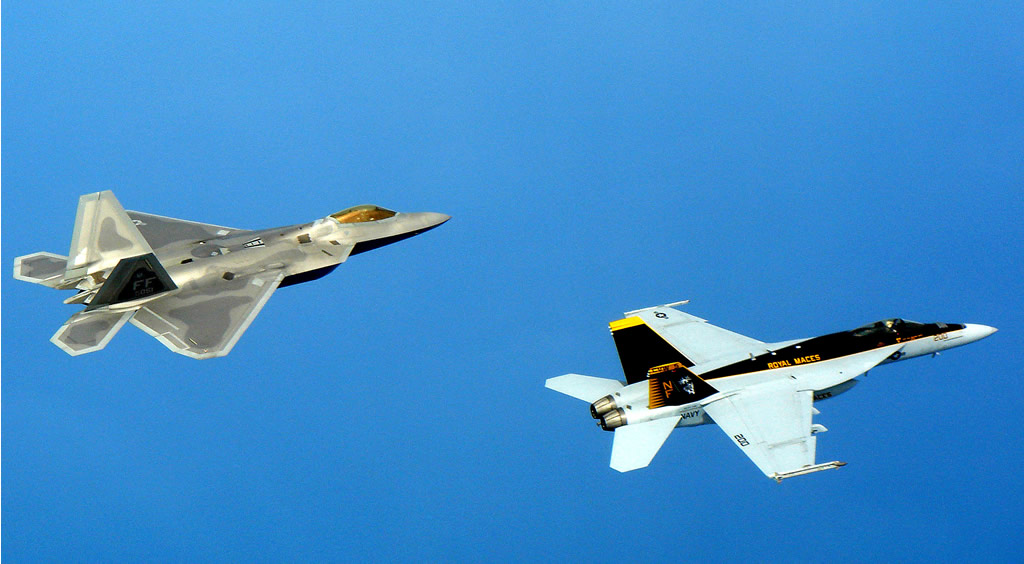 F-22 Raptors deployed to Kadena Air Base, Japan, trained with US Navy F/A-18 Super Hornets April 26, 2007, near the waters of Okinawa. US Navy Photo