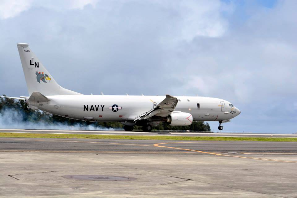 A P-8 Poseidon aircraft belonging to the 'Pelicans' of Patrol Squadron (VP) 45 returns from a mission during Rim of the Pacific (RIMPAC) Exercise 2014 in July. US Navy Photo
