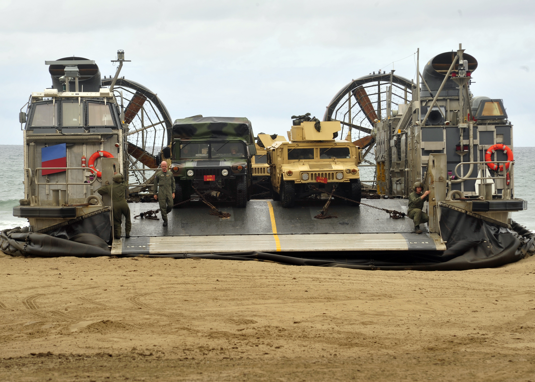 Sailors assigned to Assault Craft Unit (ACU) 5 prepare to unload Humvees from a landing craft, air cushion (LCAC) during amphibious assault training as part of exercise Dawn Blitz in June 2013. US Navy photo.