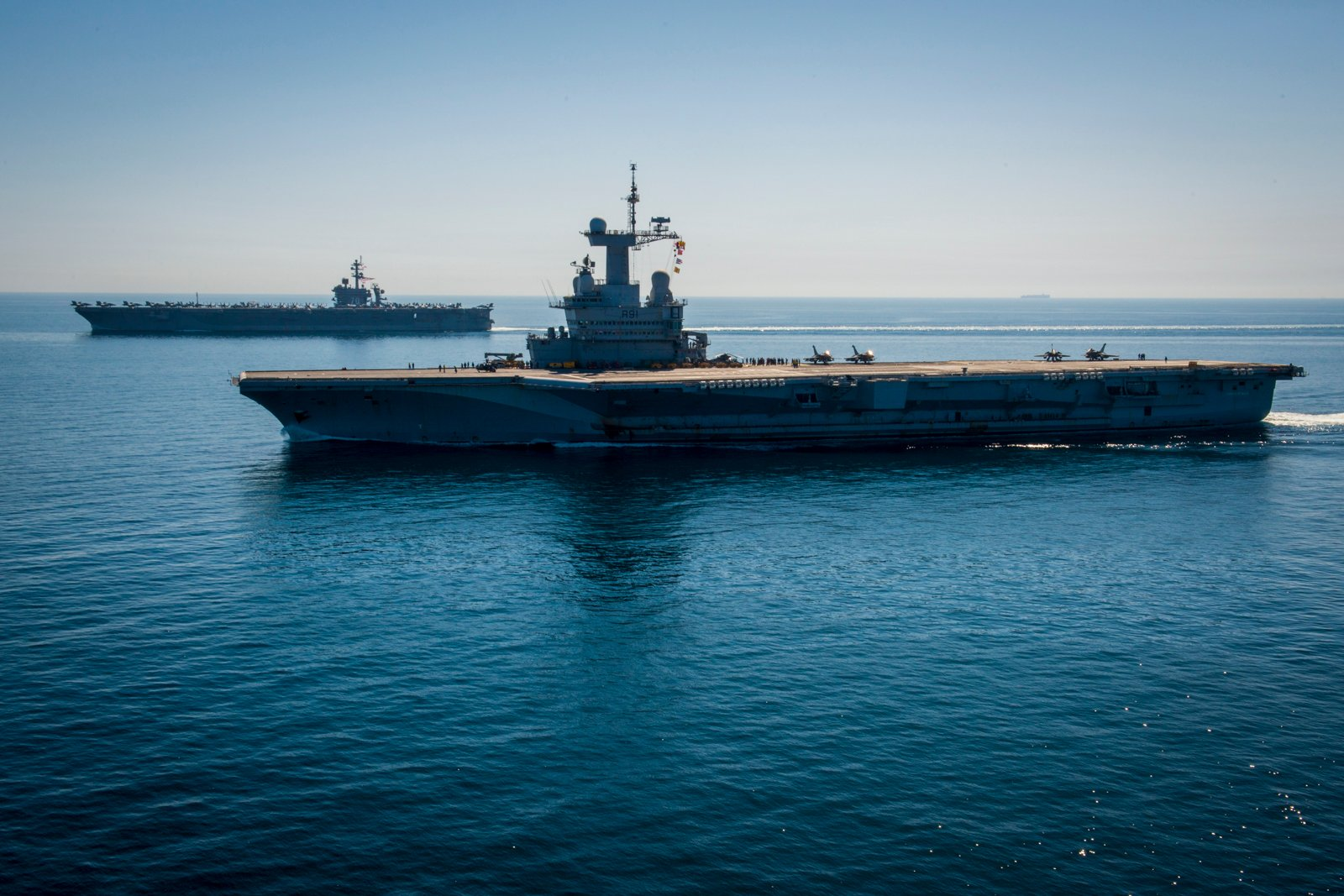 USS Carl Vinson (CVN 70), left, and the French nuclear aircraft carrier Charles de Gaulle (R91) transit the Northern Arabian Gulf on March 8, 2015. US Navy Photo
