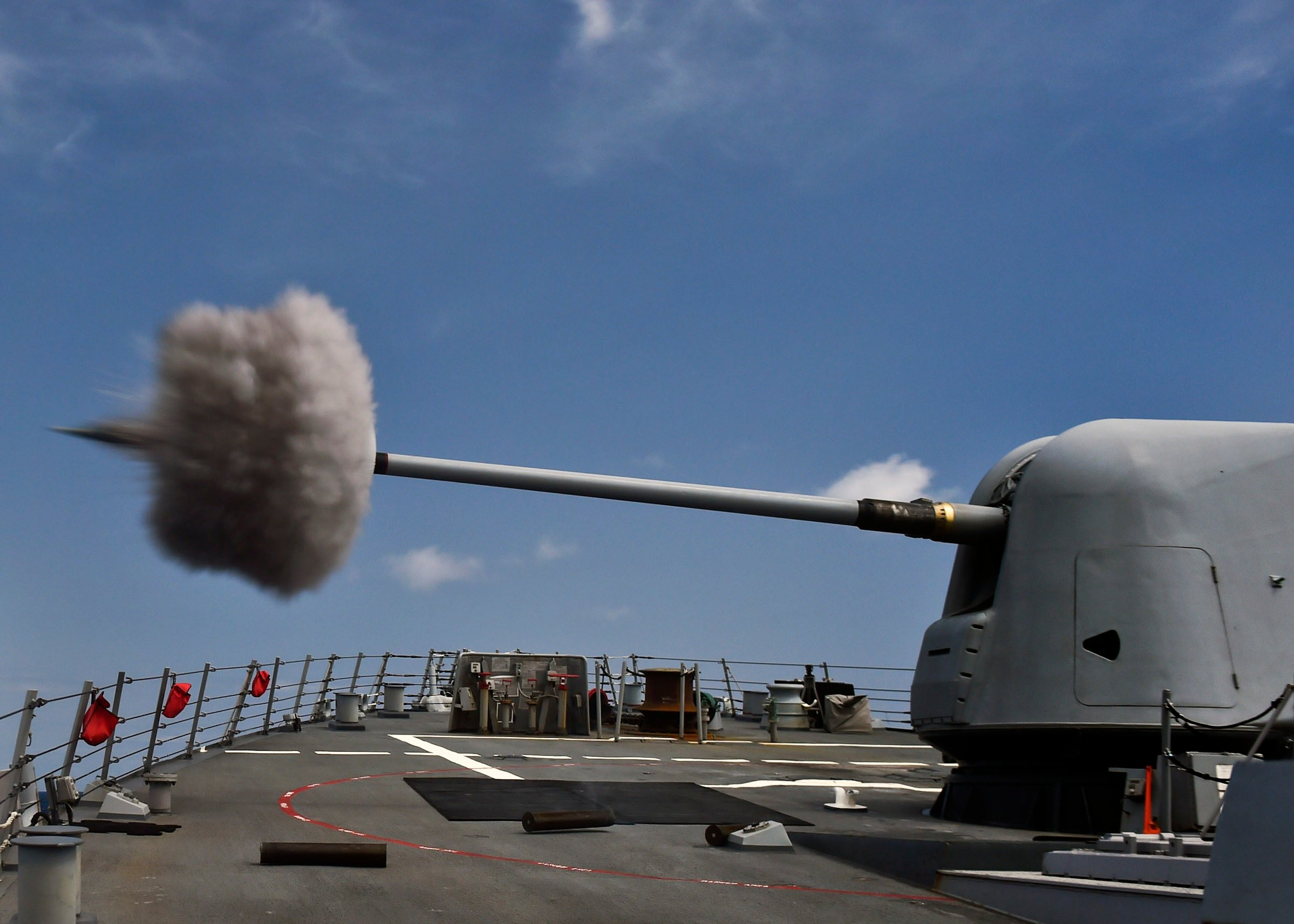 USS Porter (DDG-78) fires its MK 45 5-inch lightweight gun during a weapons training exercise on April 3, 2015. US Navy Photo