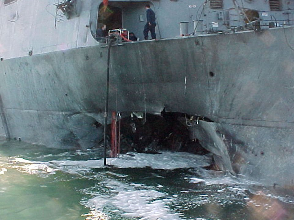 USS Cole after 2000 al-Qaeda suicide attack. US Navy Photo