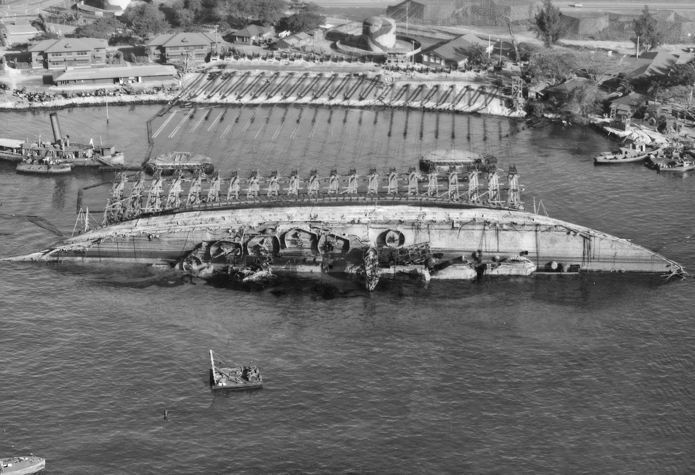 The Navy attempts to right USS Oklahoma on March 19, 1943. National Archives photo.