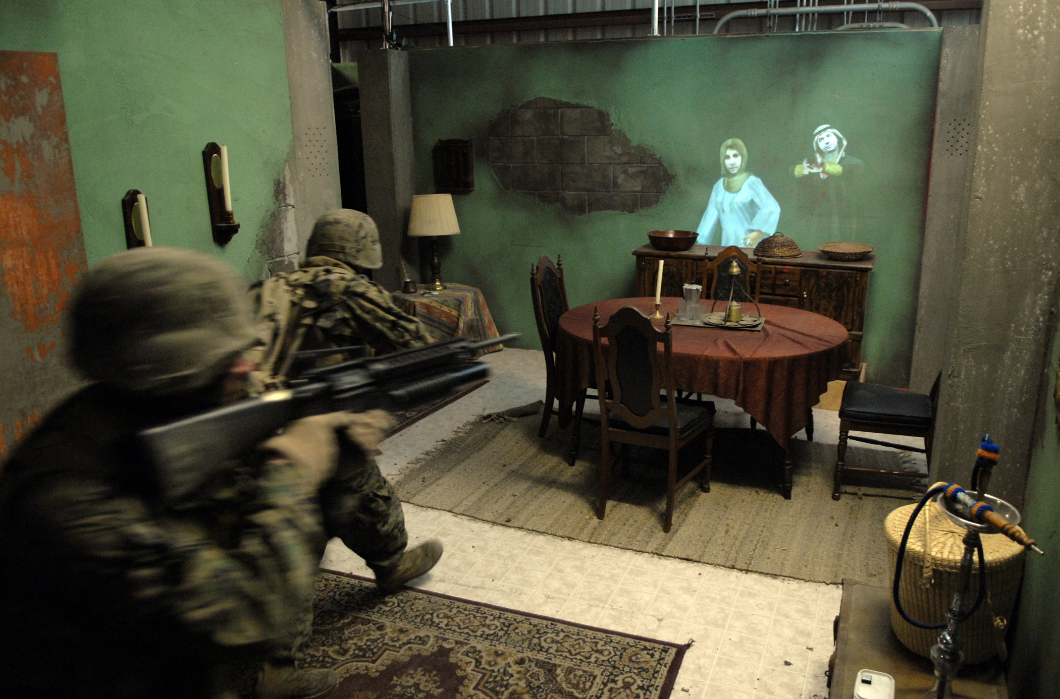 U.S. Marines with 3rd Battalion, 1st Marine Regiment, confront avatars, or virtual humans, while clearing a room at the Office of Naval Research Infantry Immersion Trainer (IIT) located at the I Marine Expeditionary Force Battle Simulation Center at Marine Corps Base Camp Pendleton, Calif., Feb. 19, 2008. US Navy photo.