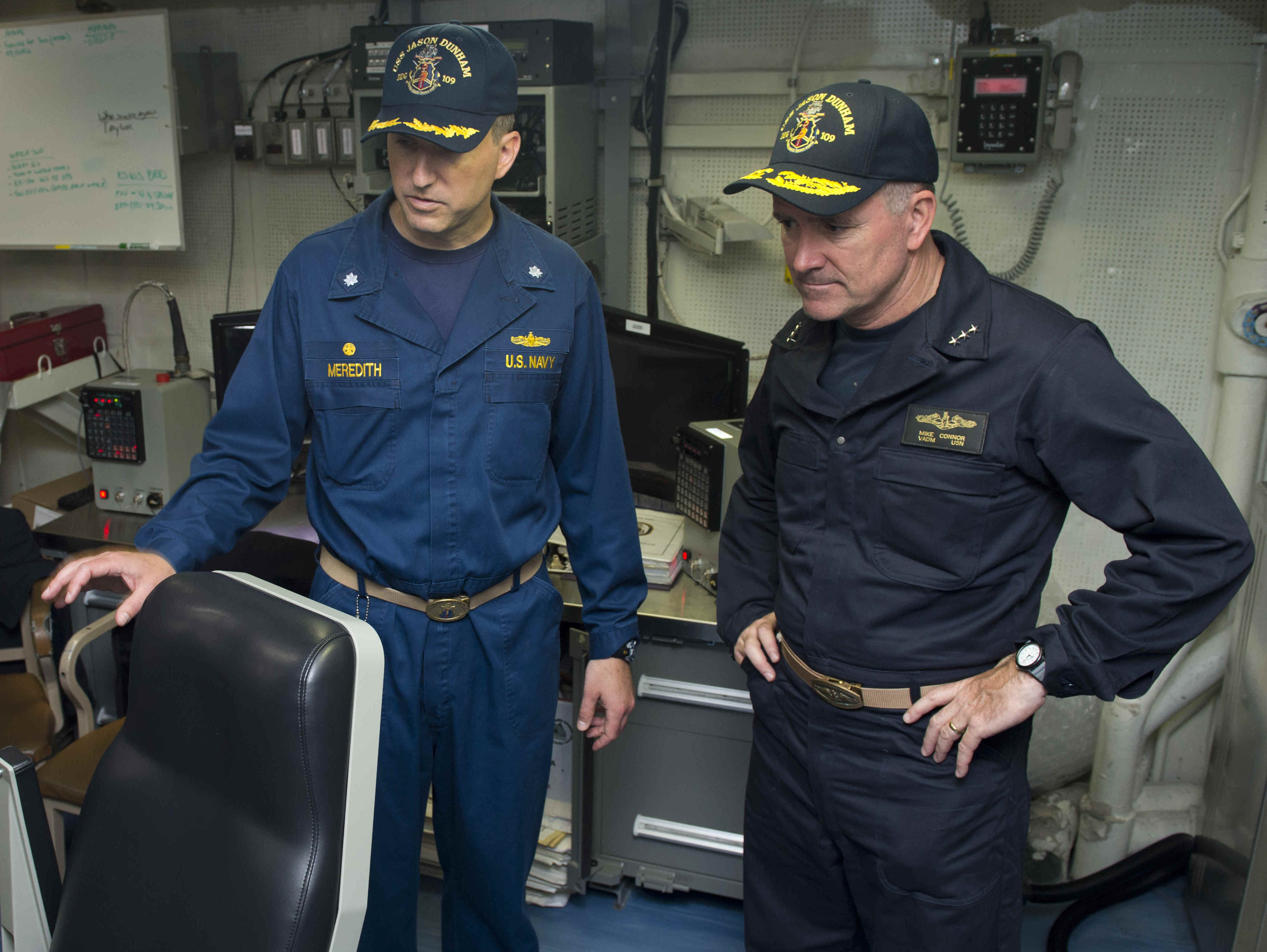 Vice Adm. Michael Connor, commander of Submarine Forces Atlantic, talks with Cmdr. Michael Meredith, commanding officer of the guided-missile destroyer USS Jason Dunham (DDG-109) on May 21, 2014. US Navy Photo