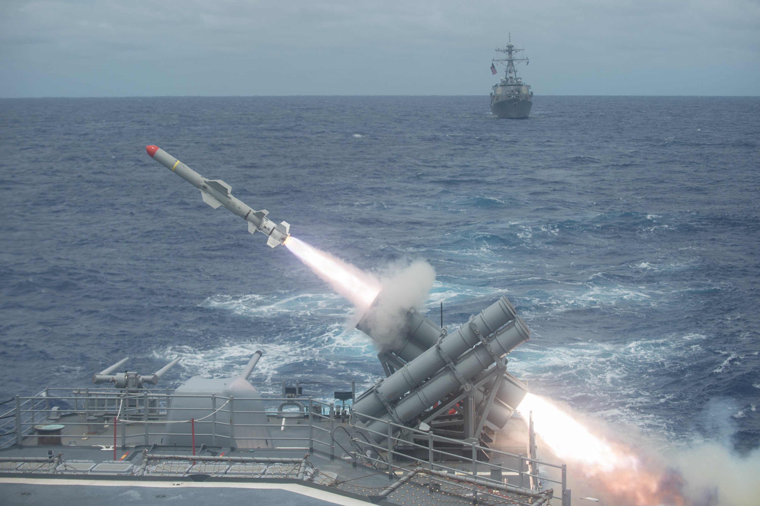 A Harpoon missile is launched from the Ticonderoga-class guided-missile cruiser USS Shiloh (CG-67) during a live-fire exercise on Sept. 15, 2014. US Navy Photo