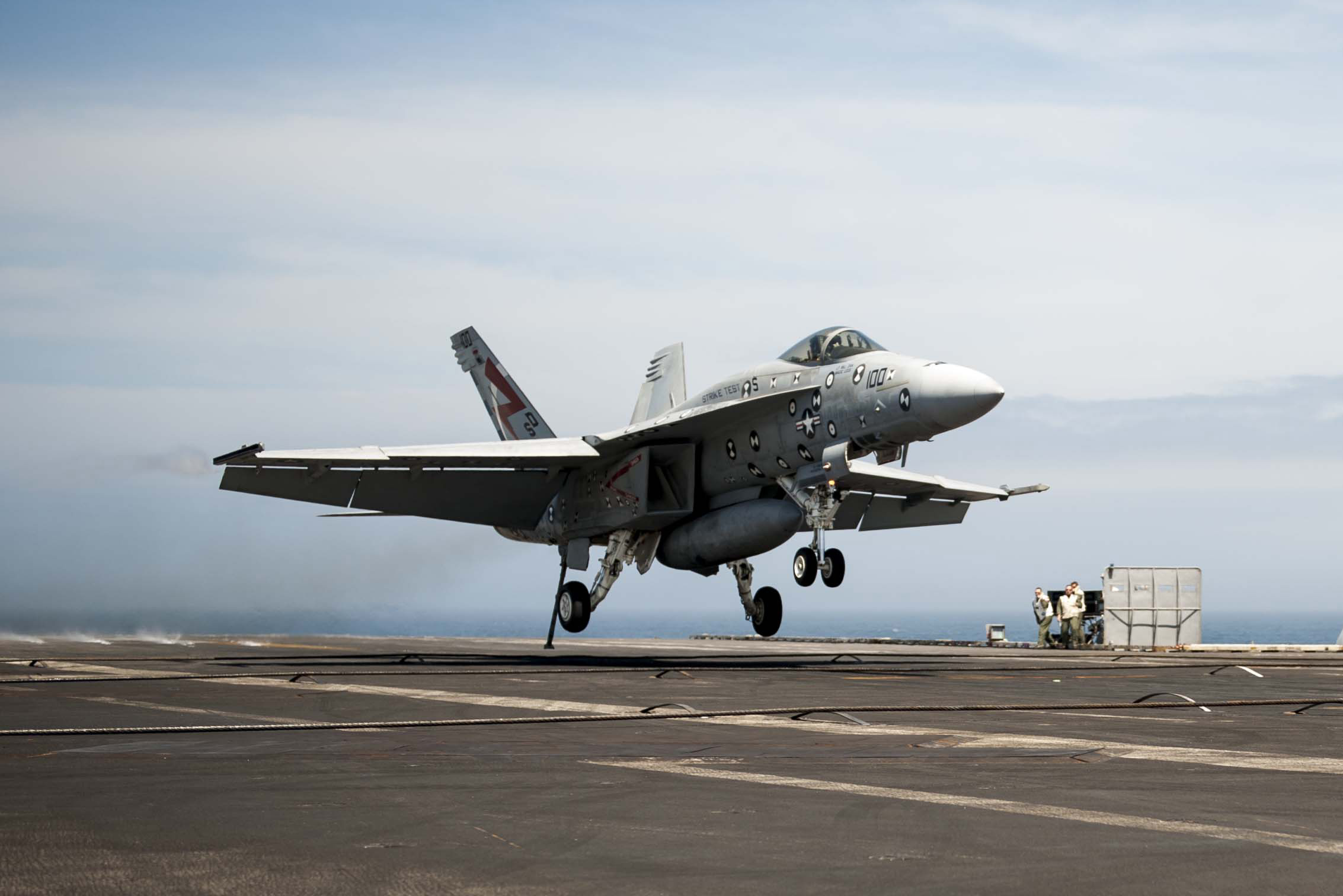 """Salty Dog 100,"" an F/A-18F Super Hornet assigned to Air Test and Evaluation Squadron (VX) 23 at Naval Air Station Patuxent River, Md., lands on USS George H. W. Bush (CVN 77) Apr. 20, 2015. The landing was part of the first sea trials for MAGIC CARPET, new flight control software and display symbology for F/A-18 aircraft designed to make carrier landings less demanding for Navy pilots. US Navy photo."