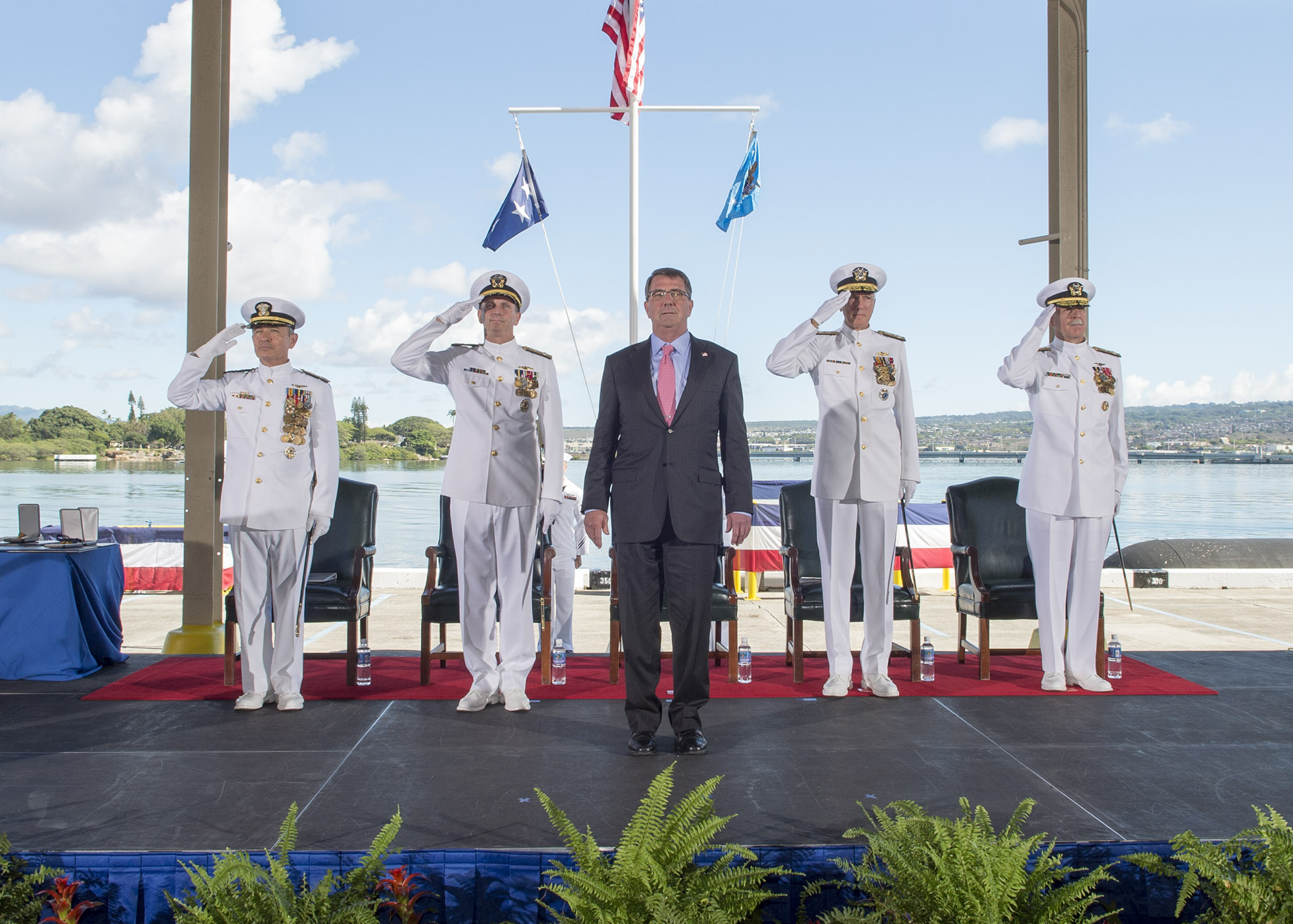 Adm. Harry B. Harris Jr., left, Chief of Naval Operations (CNO) Adm. Jonathan W. Greenert, Secretary of Defense (SECDEF) Ashton Carter, Adm. Samuel J. Locklear III, and Adm. Scott H. Swift, render honors during the joint U.S. Pacific Command (USPACOM) and U.S. Pacific Fleet (PACFLT) change of command ceremony at Joint Base Pearl Harbor-Hickam on May 27, 2015. US Navy photo.