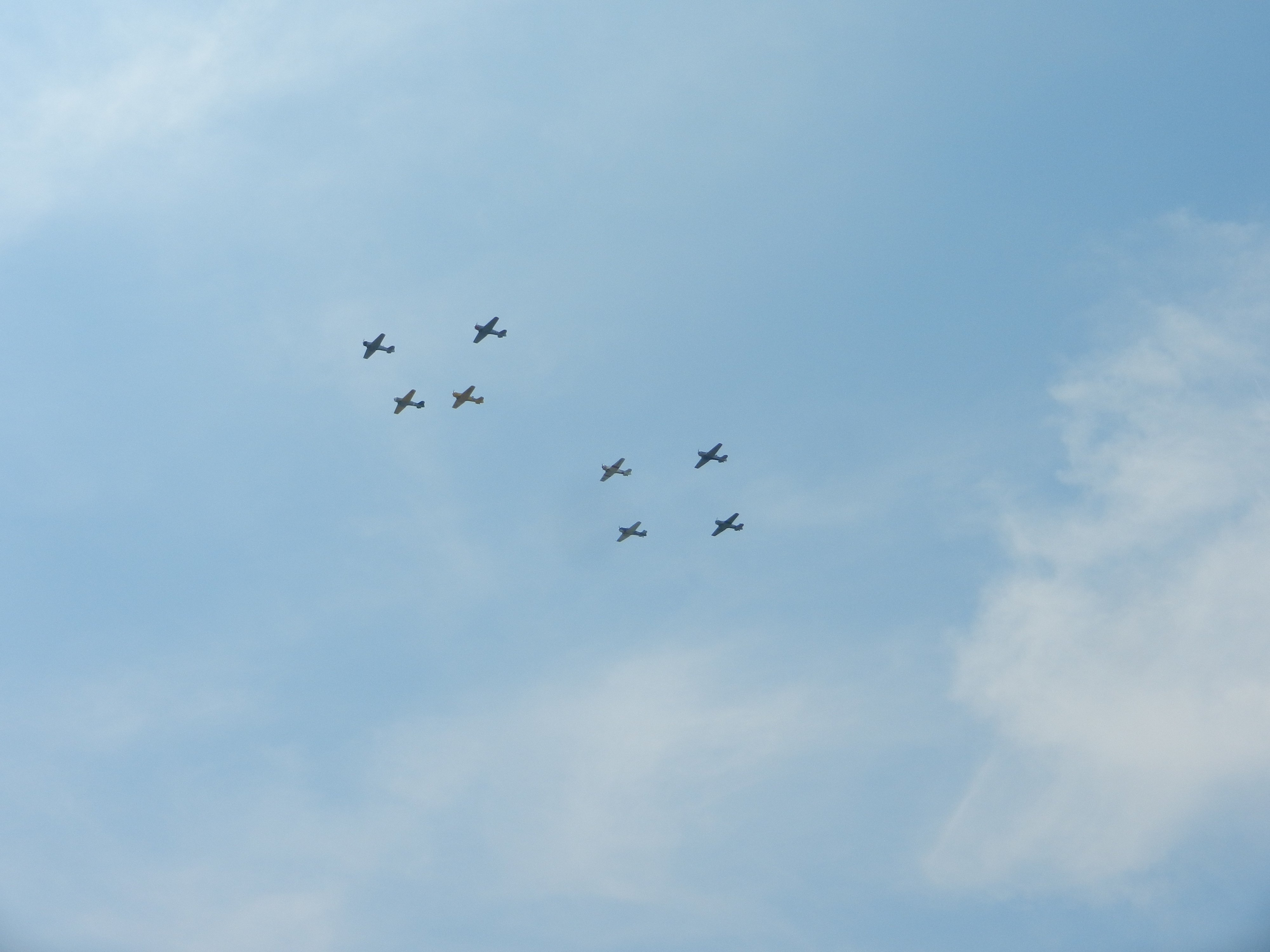 A formation of AT-6/SNJ trainers that taught pilots how to fly and shoot. Photo by Megan Eckstein, USNI News.