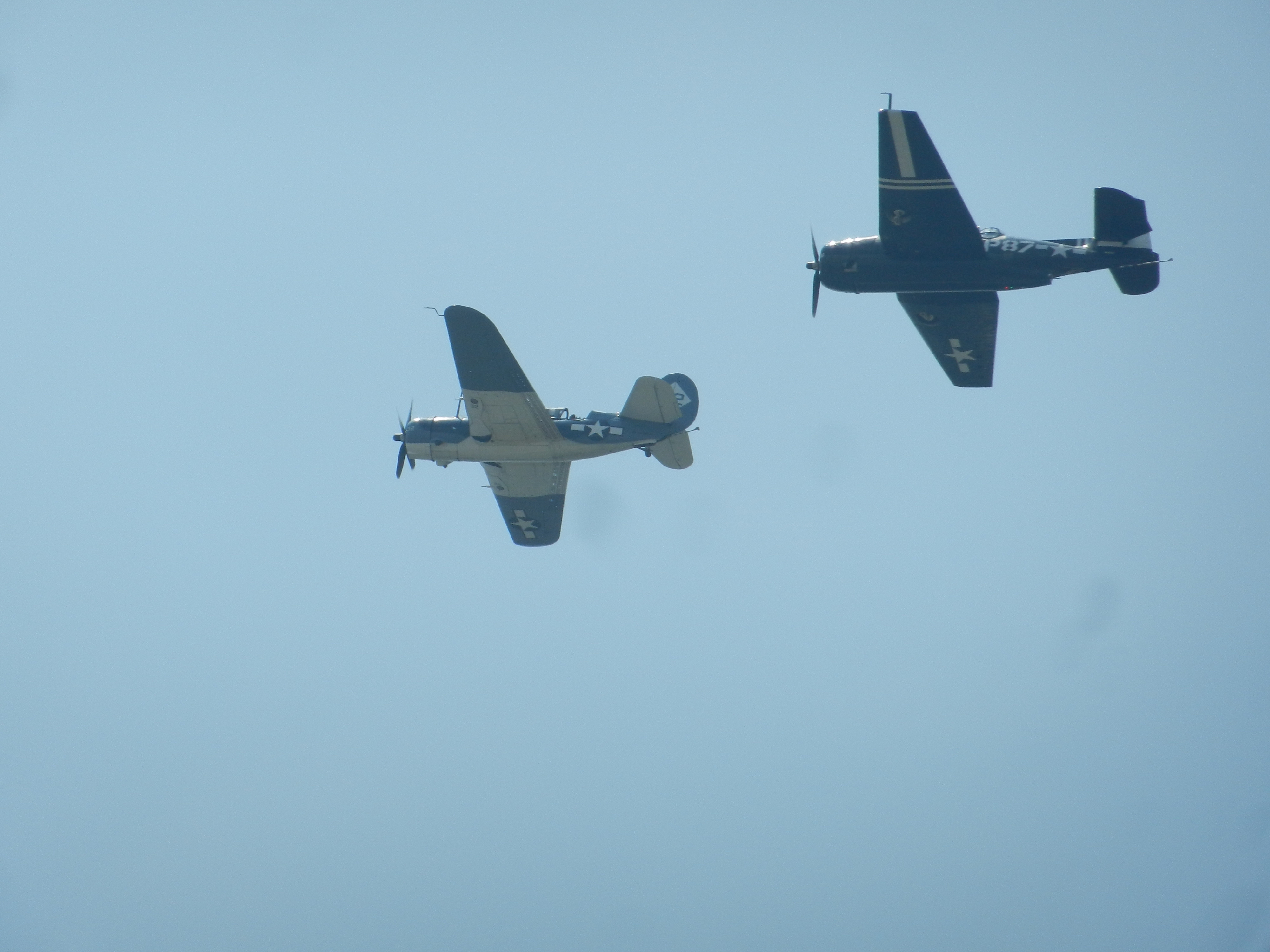 A Grumman TBM Avenger and Curtiss SB2C Helldiver. The Avenger was a carrier-based torpedo bomber that went after Japanese ships and submarines, and the Helldiver was the Navy's last diver.
