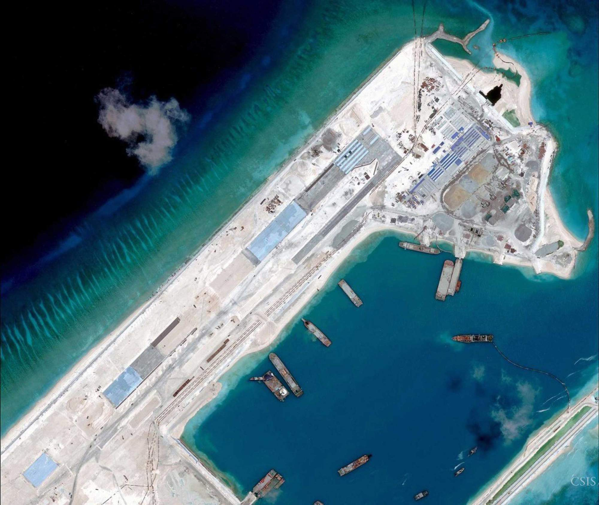 essay s island building campaign could hint toward further airstrip construction on the fiery cross reef in the south sea is pictured in this