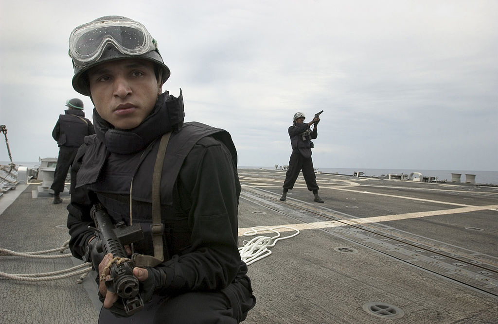 Indian Navy sailor B.K. Gurung holds his position on the flight deck of USS Mustin (DDG-89) during a visit, board, search and seizure drill April 7, 2007. US Navy Photo