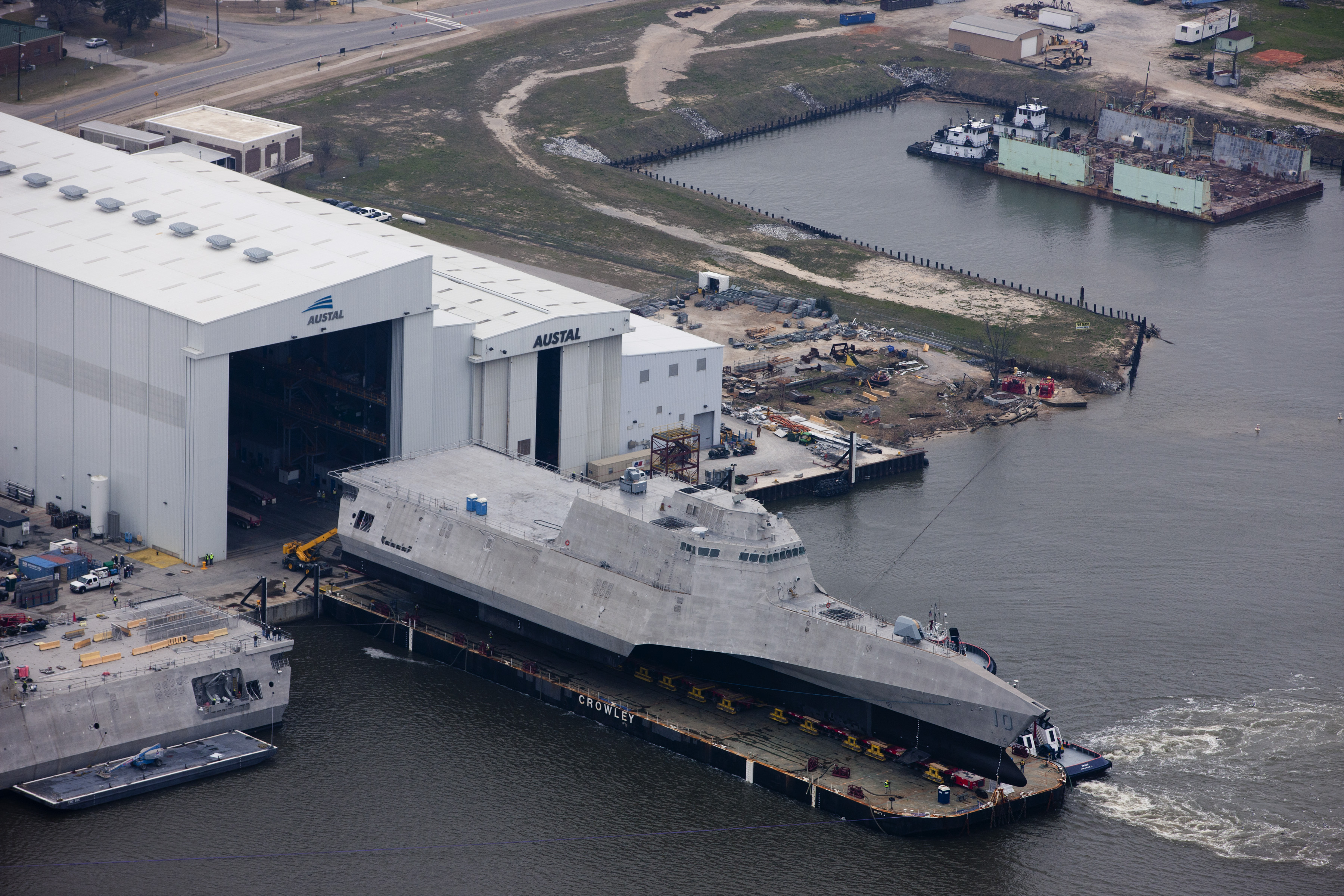 Aerial view of the future littoral combat ship USS Gabrielle Giffords (LCS 10) during its launch sequence at the Austal USA shipyard on Feb. 24, 2015. US Navy Photo