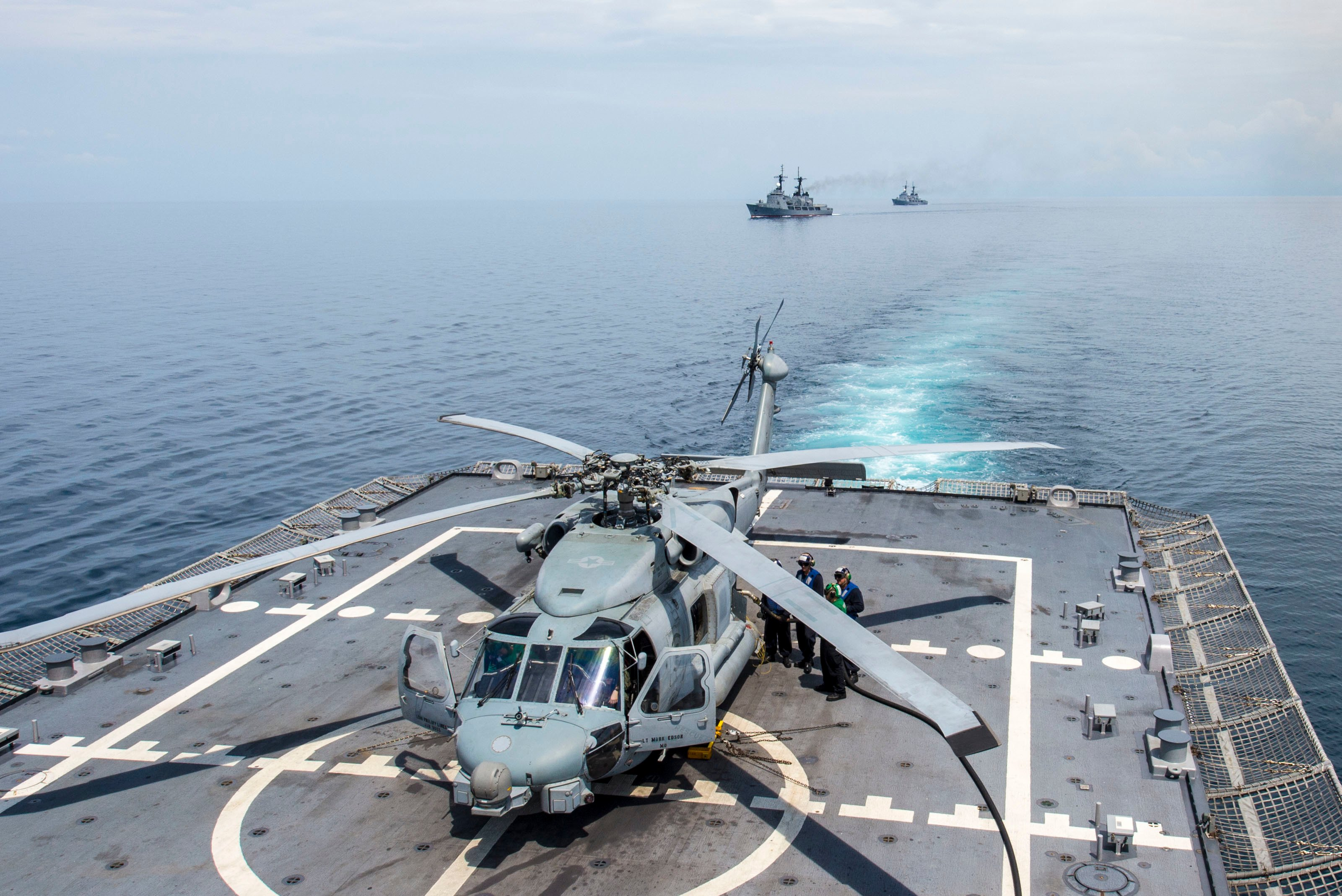 Sailors refuel an MH-60R Sea Hawk helicopter attached to Helicopter Maritime Strike Squadron (HSM) 35 aboard the littoral combat ship USS Fort Worth (LCS 3) during a maneuvering exercise with Philippine navy ships BRP Gregorio del Pilar (PF 15) and BRP Ramon Alcaraz (PF 16) in the South China Sea on June 24, 2015. US Navy photo.