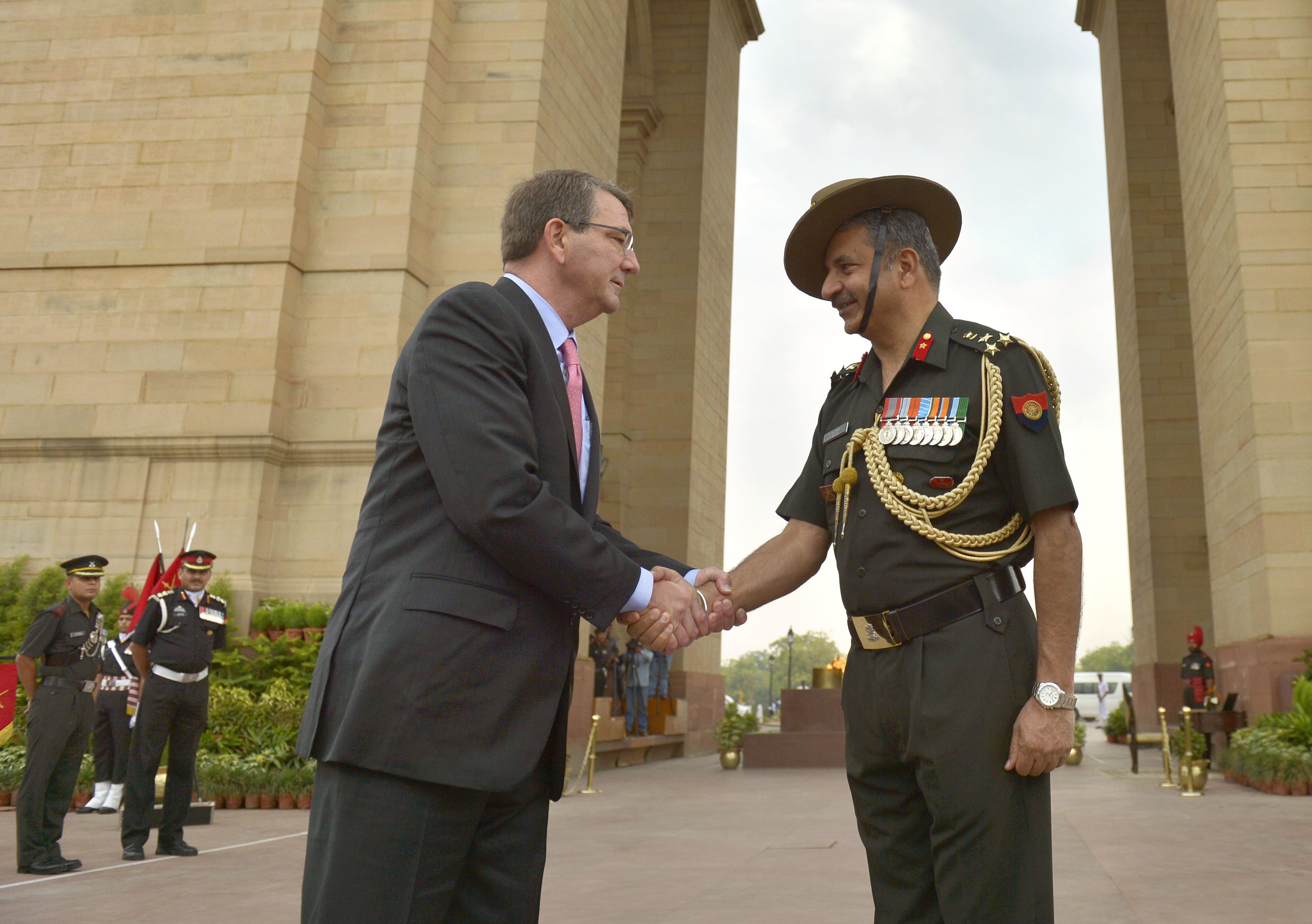 Secretary of Defense Ash Carter shakes hands with a member of the honor guard that received him to lay a wreath at India Gate in New Delhi, India, June 3, 2015. Department of Defense Photo