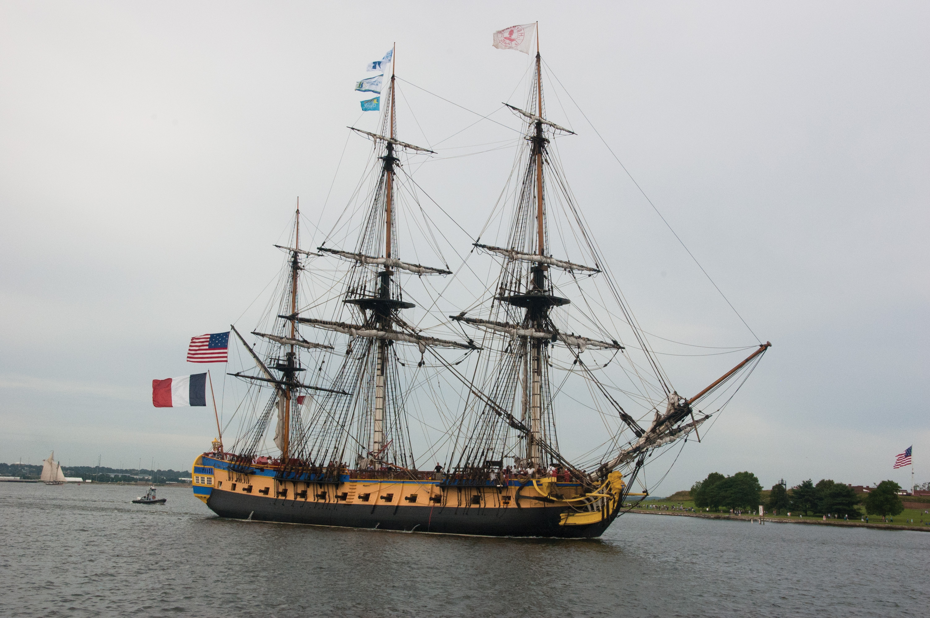 The replica French frigate Hermione sails past Fort McHenry on its way into the Inner Harbor. USNI News photo.
