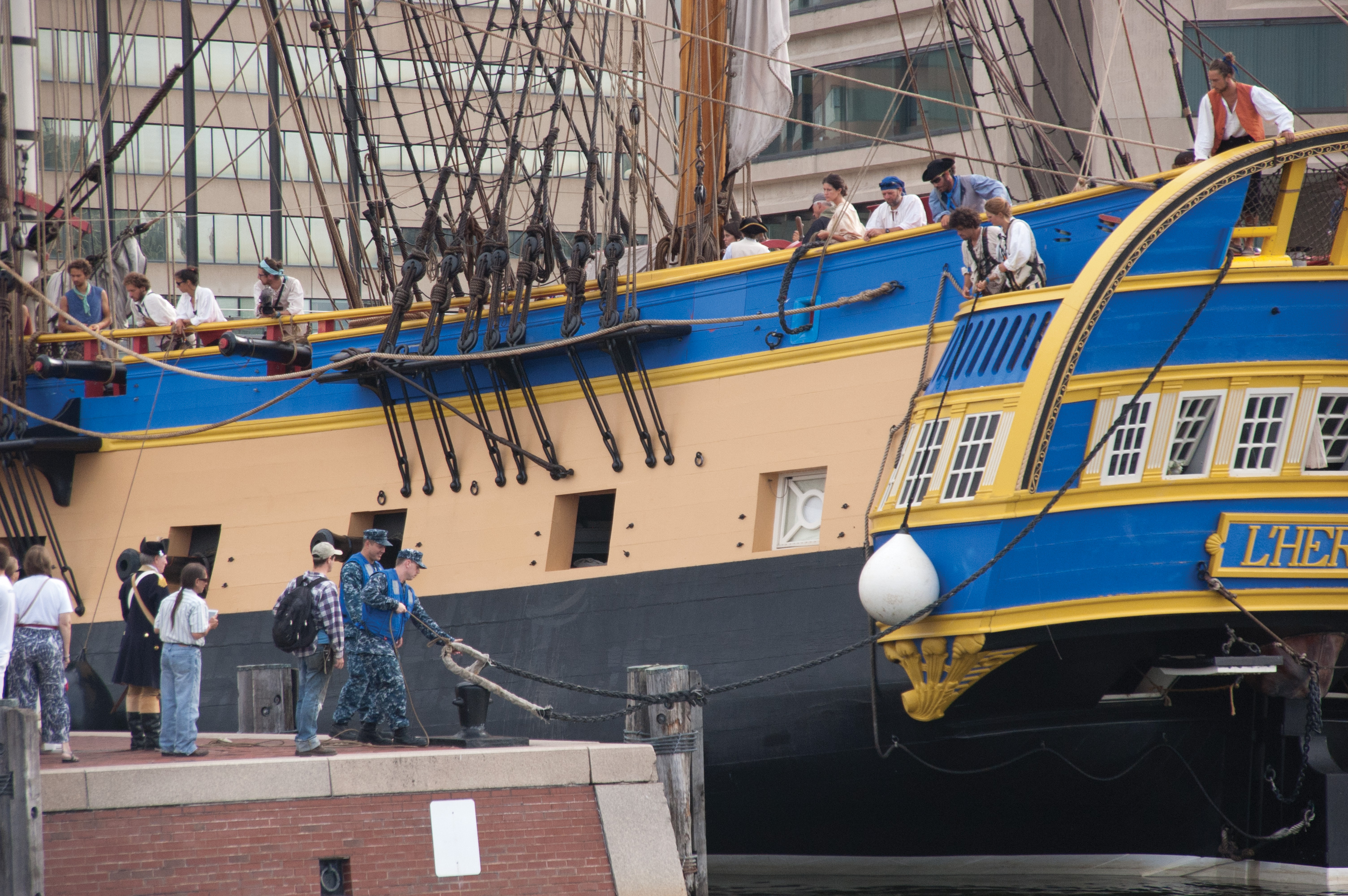Navy sailors help secure the replica Hermione in its pier in Baltimore's Inner Harbor. USNI News photo.
