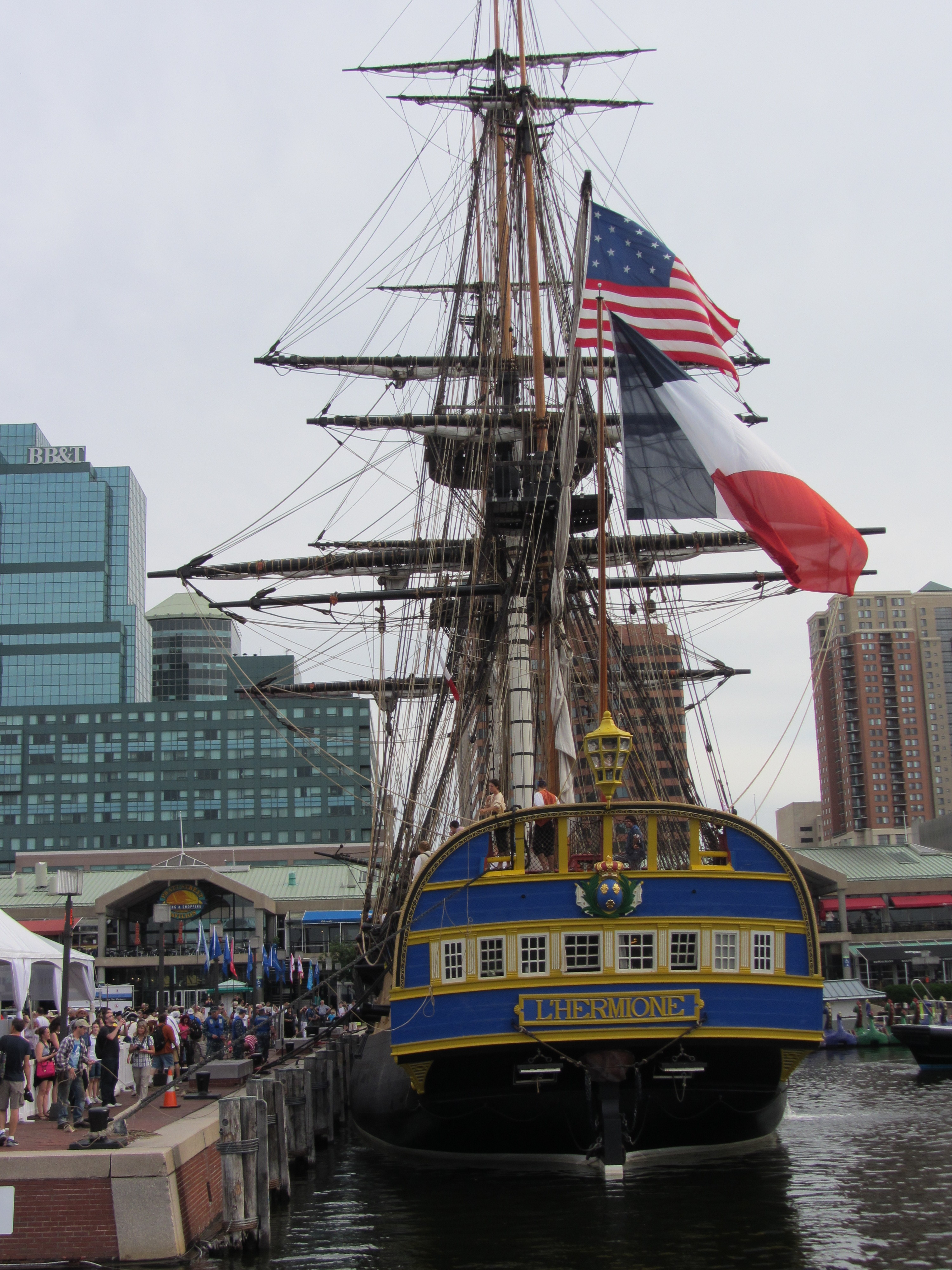 The replica of French frigate Hermione sits at a pier in Baltimore's Inner Harbor prior to a welcome ceremony featuring local and national leaders and officials involved in bringing the historic relic to Baltimore. USNI News photo.