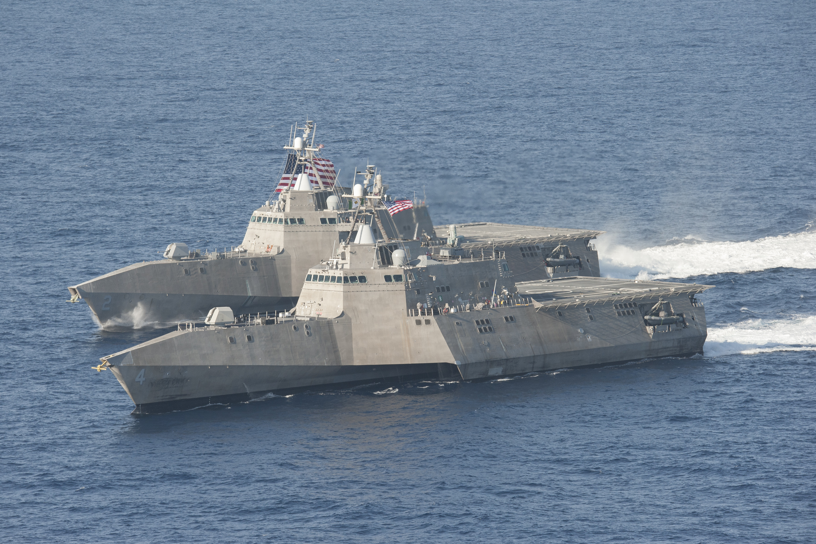 The littoral combat ships USS Independence (LCS 2), back, and USS Coronado (LCS 4) are underway in the Pacific Ocean in April 2014. US Navy photo.