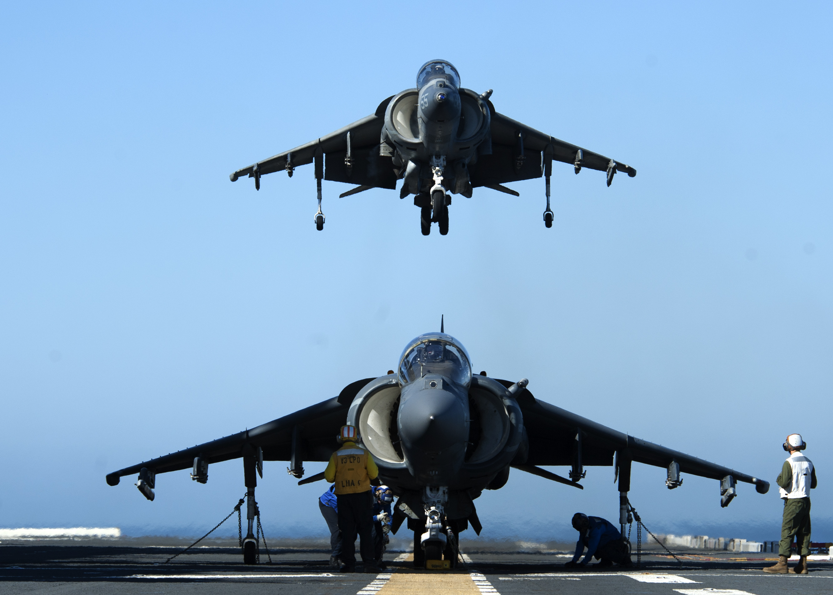 An AV-8B Harrier assigned to Marine Attack Squadron (VMA) 311 prepares to land on the flight deck of the amphibious assault ship USS America (LHA-6) on Feb. 25, 2015. US Navy Photo