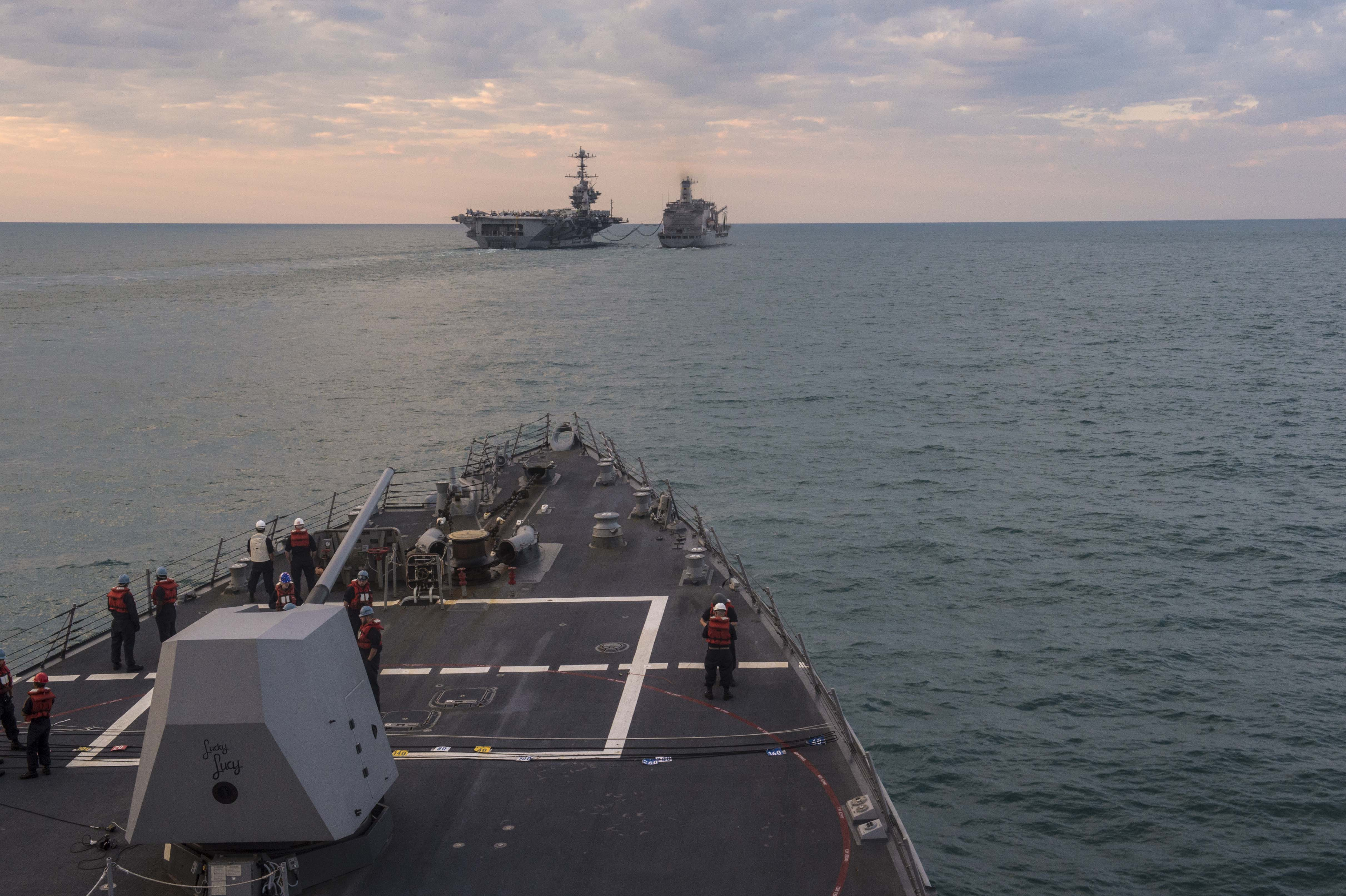 Guided-missile destroyer USS Mustin (DDG-89) prepares to come alongside the Military Sealift Command fleet replenishment oiler USNS Rappahannock (T-AO 204) as the ship conducts a replenishment-at-sea with the Nimtz-class aircraft carrier USS George Washington (CVN-73) during exercise Talisman Sabre 2015 on July 6, 2015. US Navy Photo