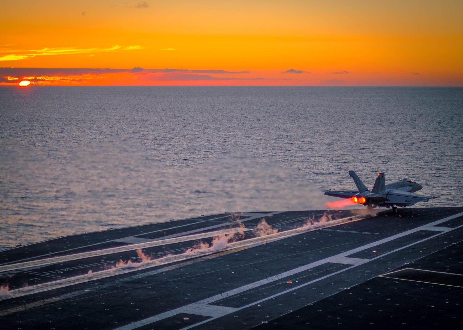An F/A-18E Super Hornet assigned to the Kestrels of Strike Fighter Squadron (VFA) 137 launches at sunset from the flight deck of the aircraft carrier USS Ronald Reagan (CVN 76) on July 10, 2015. US Navy photo.