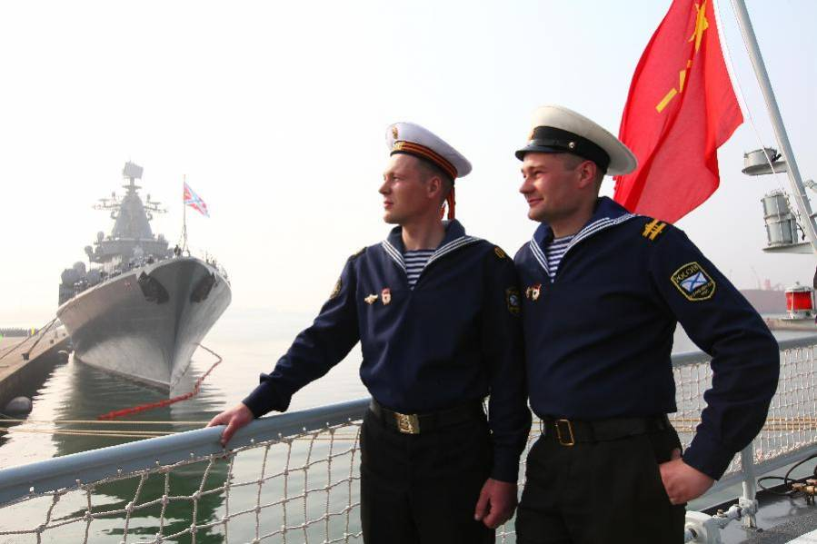 Russian sailors aboard a Chinese People's Liberation Army Navy Ship.