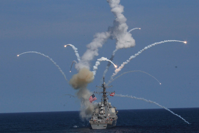 A Raytheon SM-2 Block IIIA guided missile explodes over USS The Sullivans during a training exercise on July 18, 2015. US Navy Photo obtained by USNI News