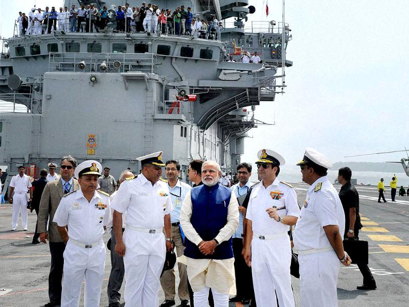 Prime Minister Narendra Modi on the deck of aircraft carrier INS Vikramaditya, in Goa. PTI photo