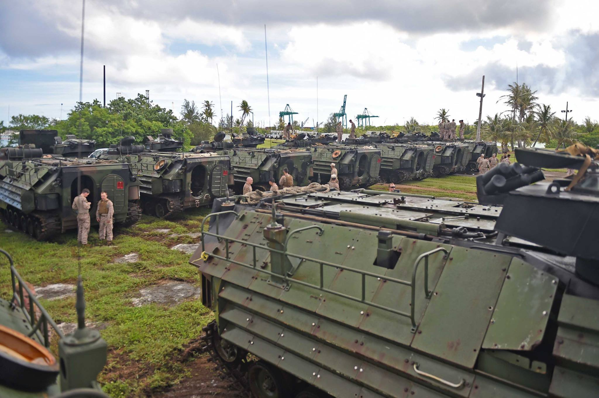 Amphibious Assault Vehicles from the 31st Marine Expeditionary Unit (MEU) arrive at the beach to allow for supplies and machinery to be loaded into the well deck of the amphibious dock landing ship USS Ashland (LSD 48) for disaster relief efforts in Saipan after Typhoon Soudelor. The 31st MEU is embarked on the amphibious dock landing ship USS Ashland (LSD 48) and is on patrol in the U.S. 7th Fleet area of operations.