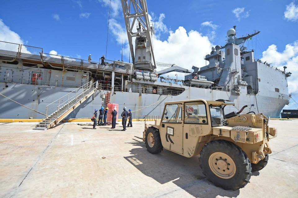 Sailors onboard the amphibious dock landing ship USS Ashland (LSD-48) offload supplies during disaster relief efforts in Saipan on Aug. 11, 2015. US Navy Photo