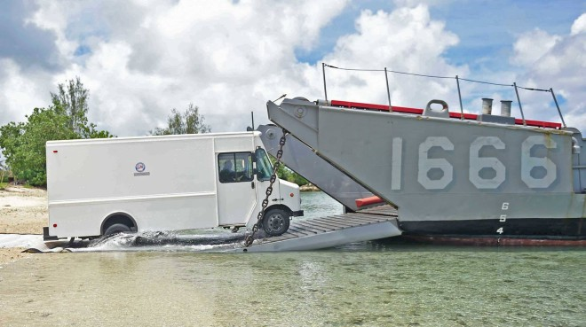 USS Ashland Returns To Saipan With Supplies To Restore Water, Power To Island