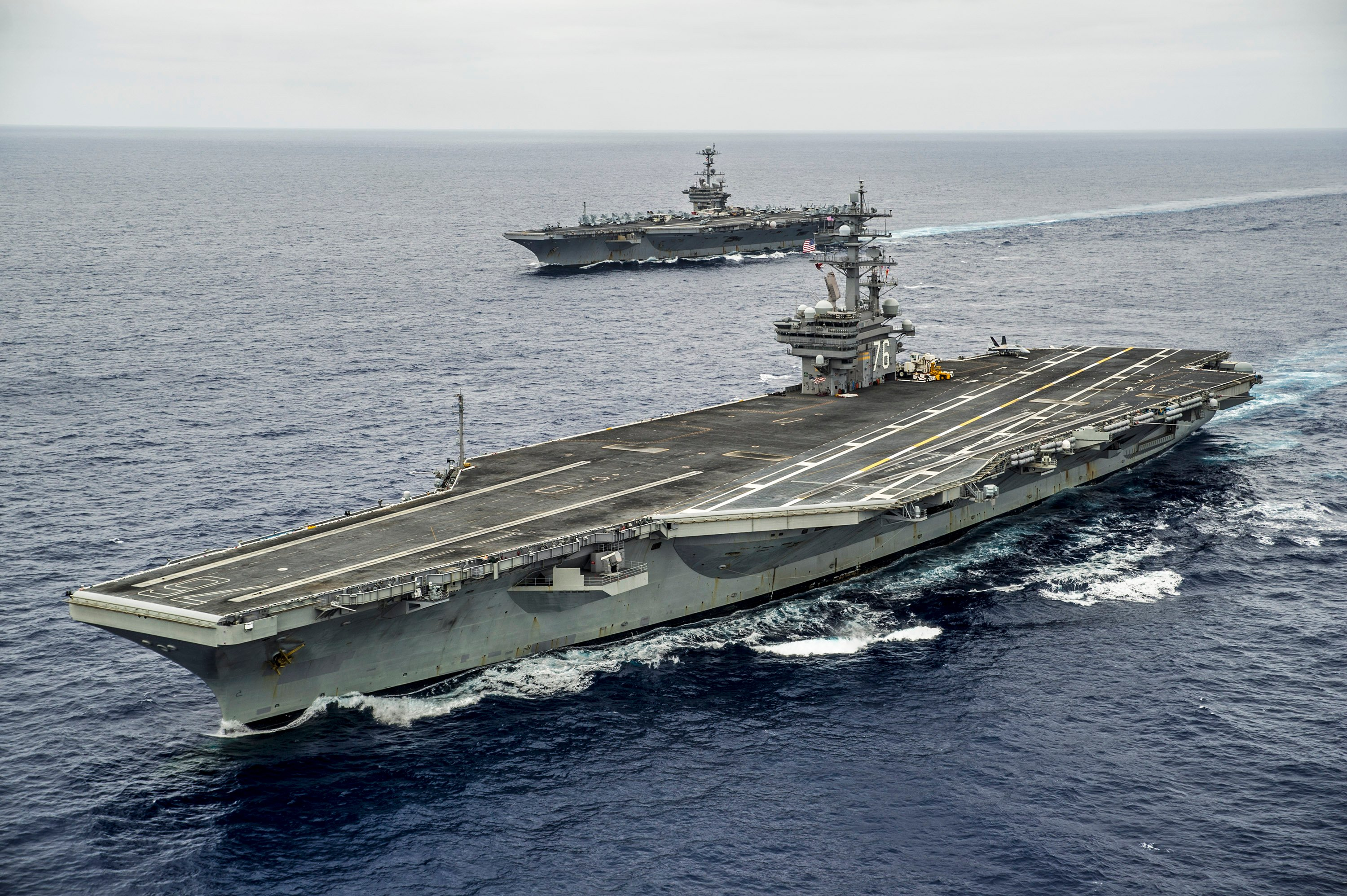 USS George Washington (CVN-73) and USS Ronald Reagan (CVN-76) transit the Pacific Ocean prior to conducting a hull-swap on Aug, 7, 2015. US Navy Photo