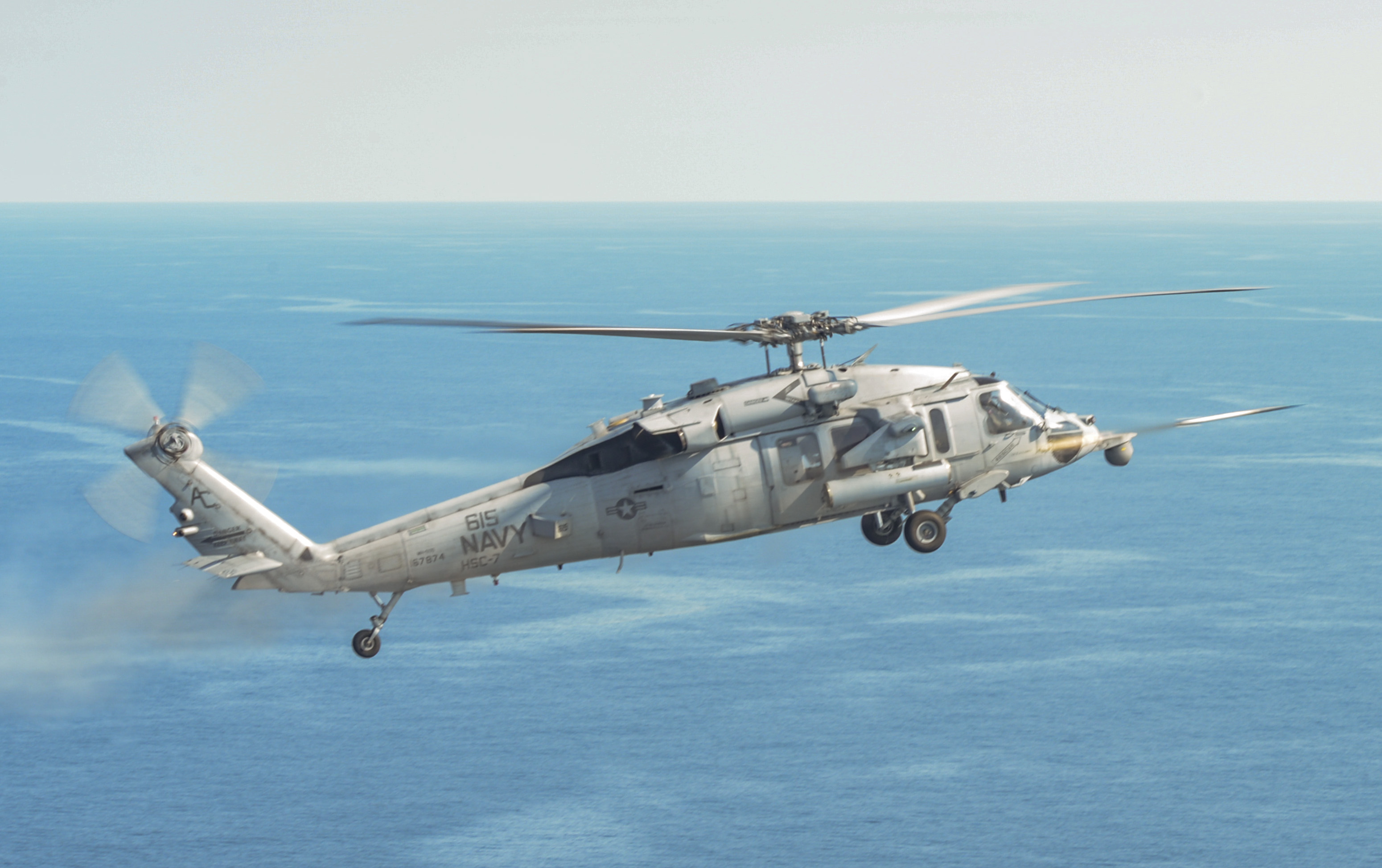 An SH-60S Sea Hawk helicopter attached to the Dusty Dogs of Helicopter Sea Combat Squadron (HSC) 7 fires an Advanced Precision Kill Weapon System II during a live-fire qualification exercise at a practice range off the Virginia coast. US Navy photo.
