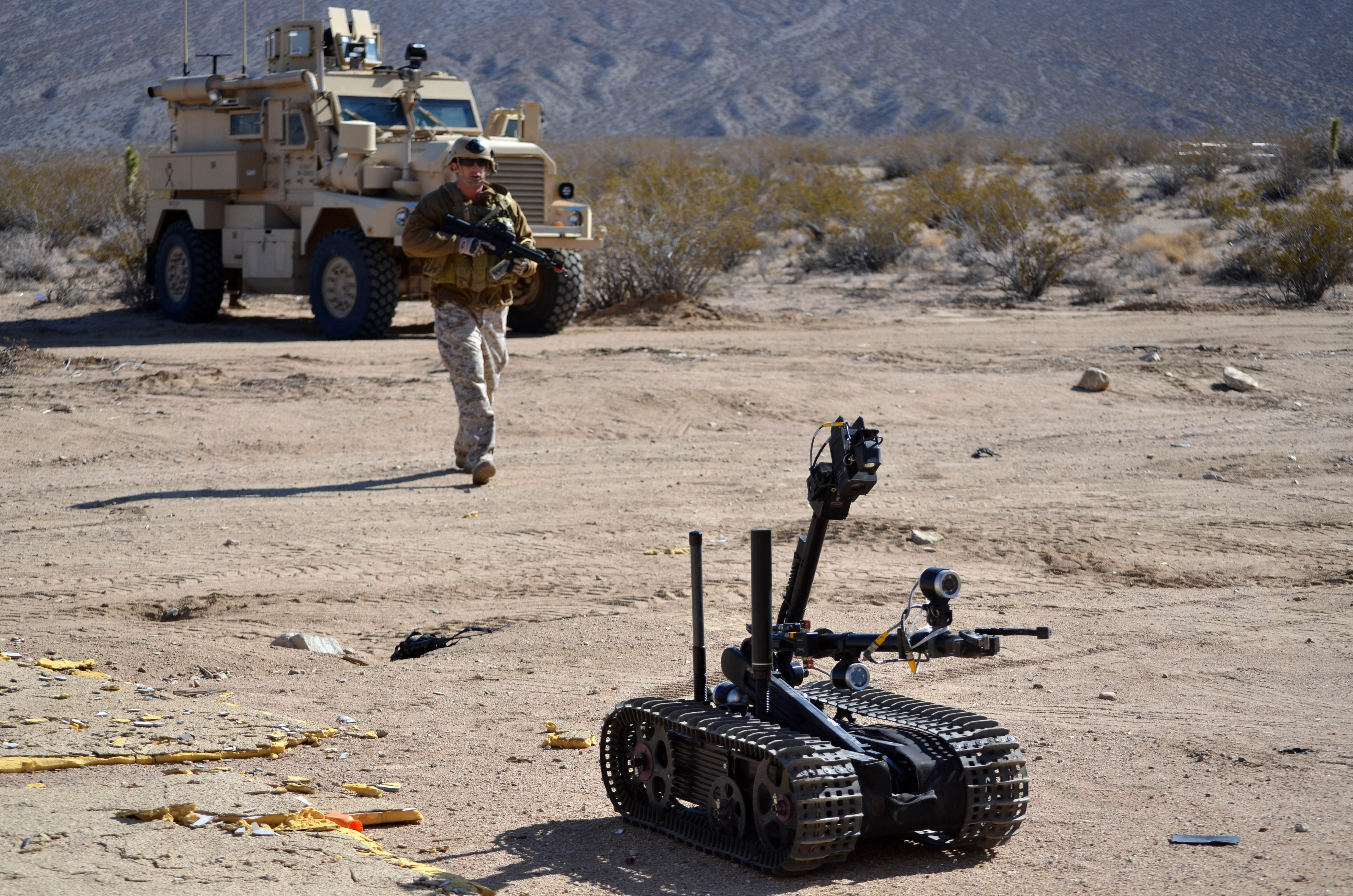 "Reserve component Sailors assigned to Explosive Ordnance Disposal Operational Support Unit 7 use a Man Transportable Robot System ""Talon"" Mark 2 to approach a suspected bomb maker's building during a mobility exercise at Naval Air Weapons Station China Lake in March 2012. AEODRS Increment 2 is meant to replace this system. US Navy photo."